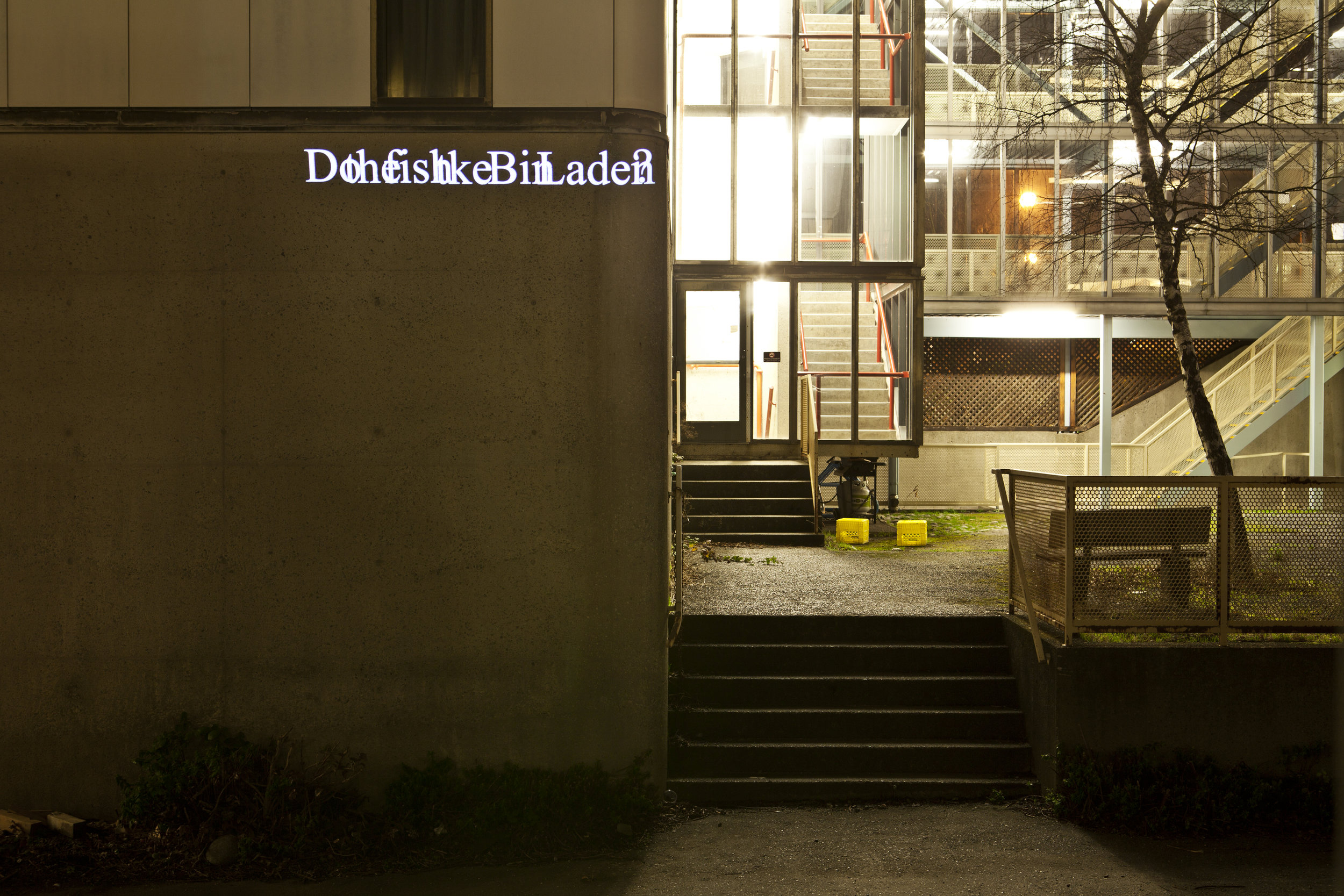 """HD Text projection onto UBC's Power building  """"  Do the Fish Like Bin Laden? """""""