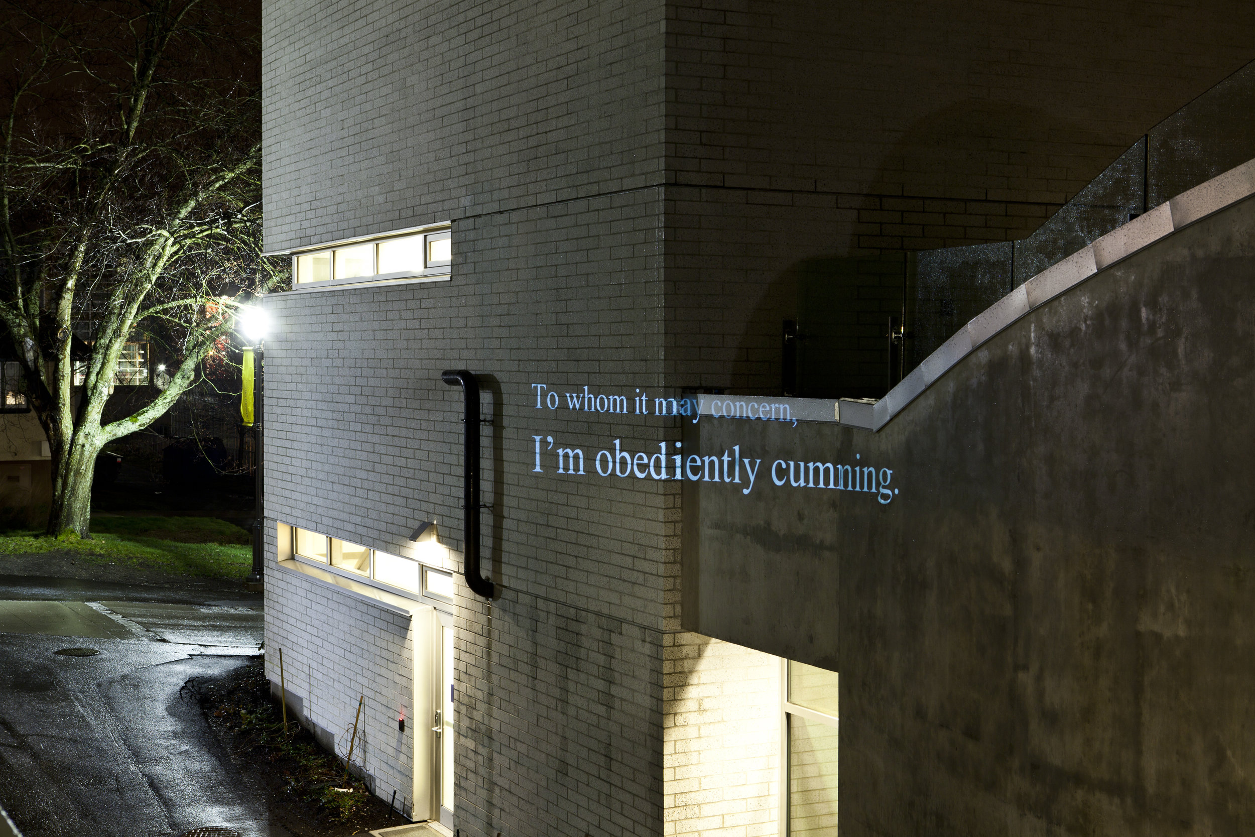 """HD Text projection onto UBC's building of  Centre for Interactive Research on   Sustainability. """"  To Whom It May Concern, I'm Obediently Cumming """""""