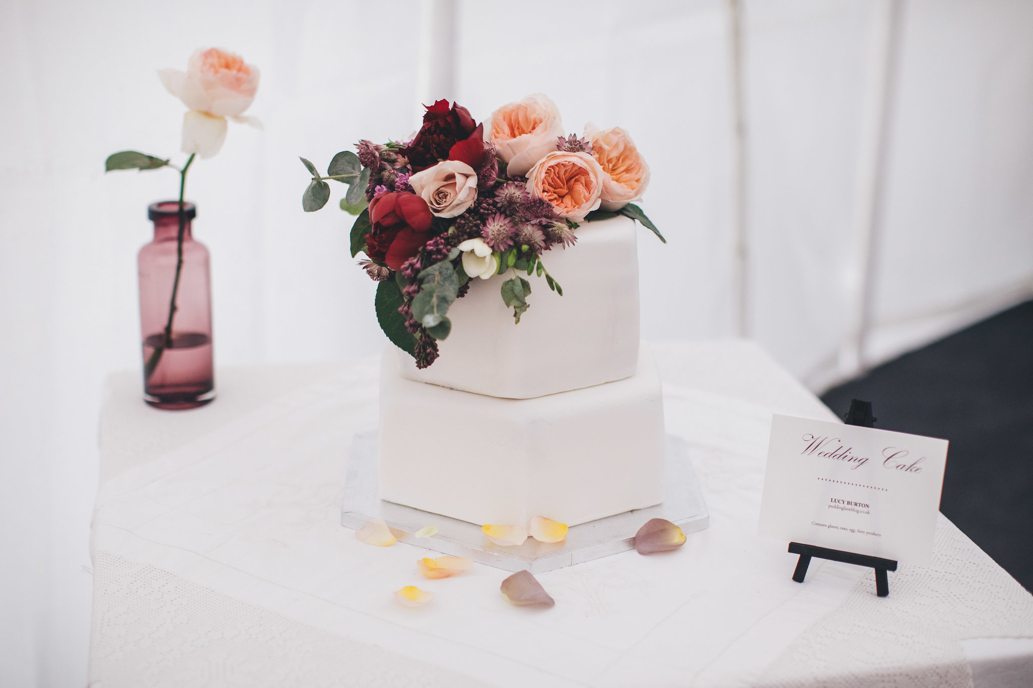 Photo credit: Mike Plunkett Photography; Florals: Swallows and Damsons