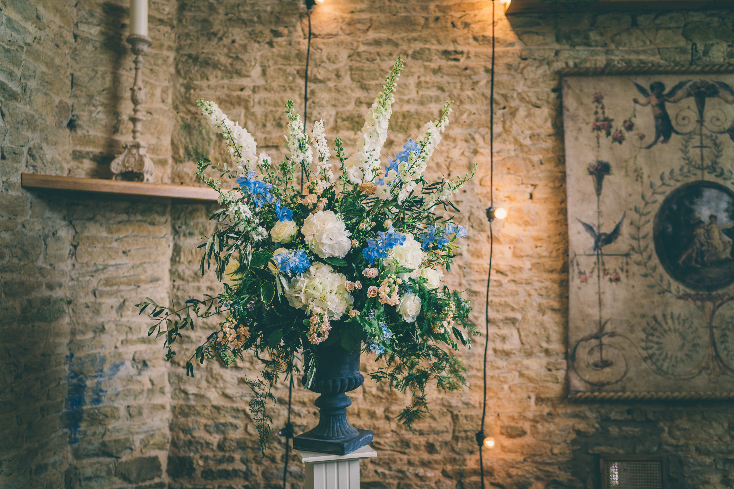 Relaxed cotswolds wedding_beautiful flower urn arrangement