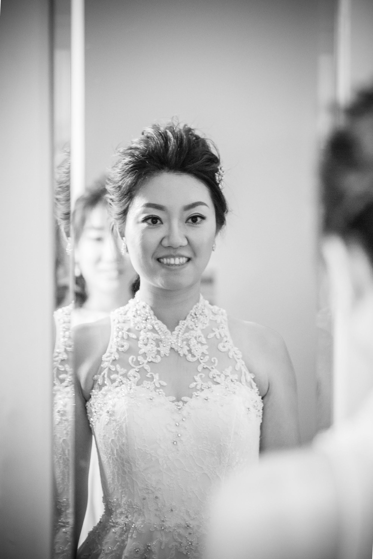 Oxford college wedding_bride admires her reflection in mirror