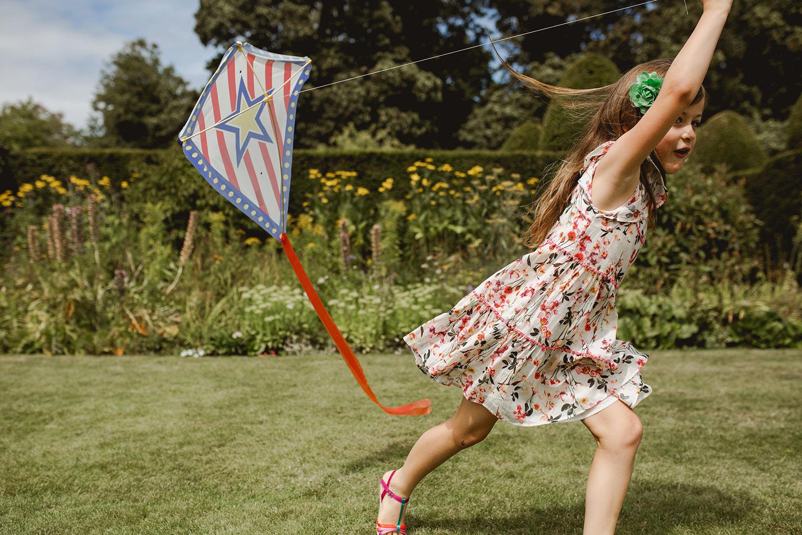 Eggington House marquee wedding_girl flies kite