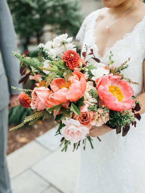 I absolutely love this beautiful bouquet by US florist,  Daffodil Parker . The coral peonies really make it pop, but the muted zinnias, roses and foliage keep it looking elegant and romantic. Photo by  Geneoh Photography .