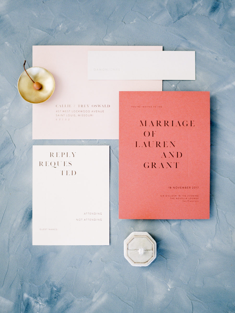 This stationery suite by  Refine Studio  is another example of how coral can be used to make a statement, but without taking over. Very chic. Photo by  Jeremy Chou .