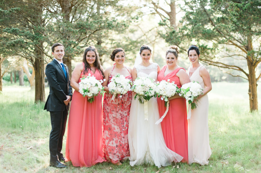 Coral is a gorgeous colour for bridesmaid outfits, especially for brunettes. Don't be afraid to experiment with different dress styles and even patterns. One size rarely fits all and you want your maids to feel comfortable and confident when they're by your side. Photo by  Leila Brewster  via Style Me Pretty.
