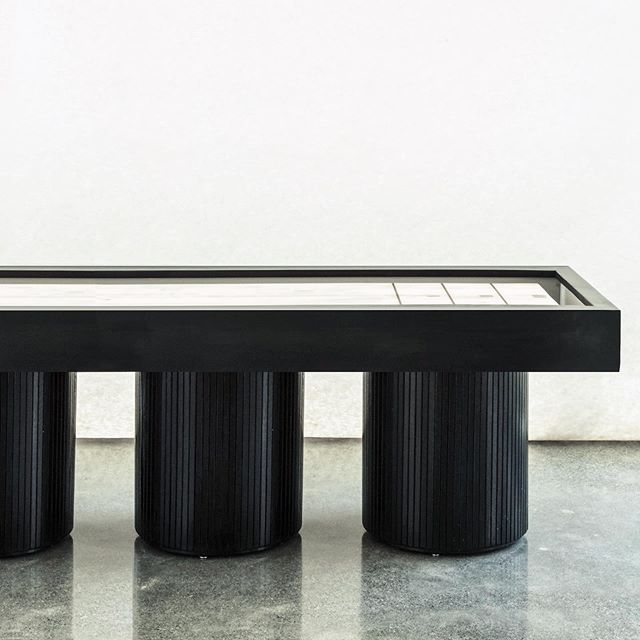 Designed and built this shuffle board table for a auto dealership converted into an apartment building in Oakland. The original as well as the new construction both emphasized the circular form throughout the space. The round columns provide solid structural footing as they tie the piece into the broader context of the room and the building.