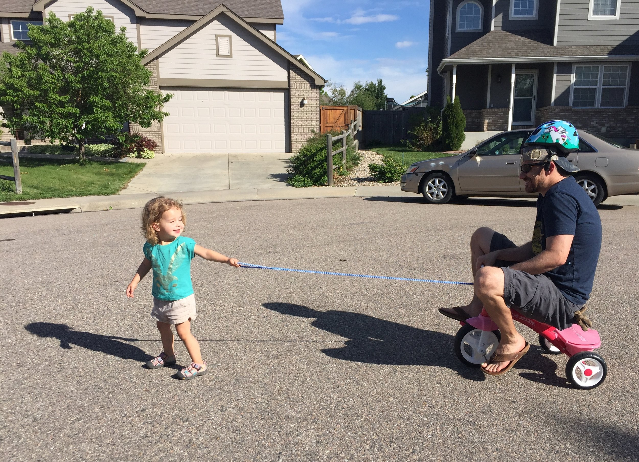 Rylee taking her dad for a bike ride