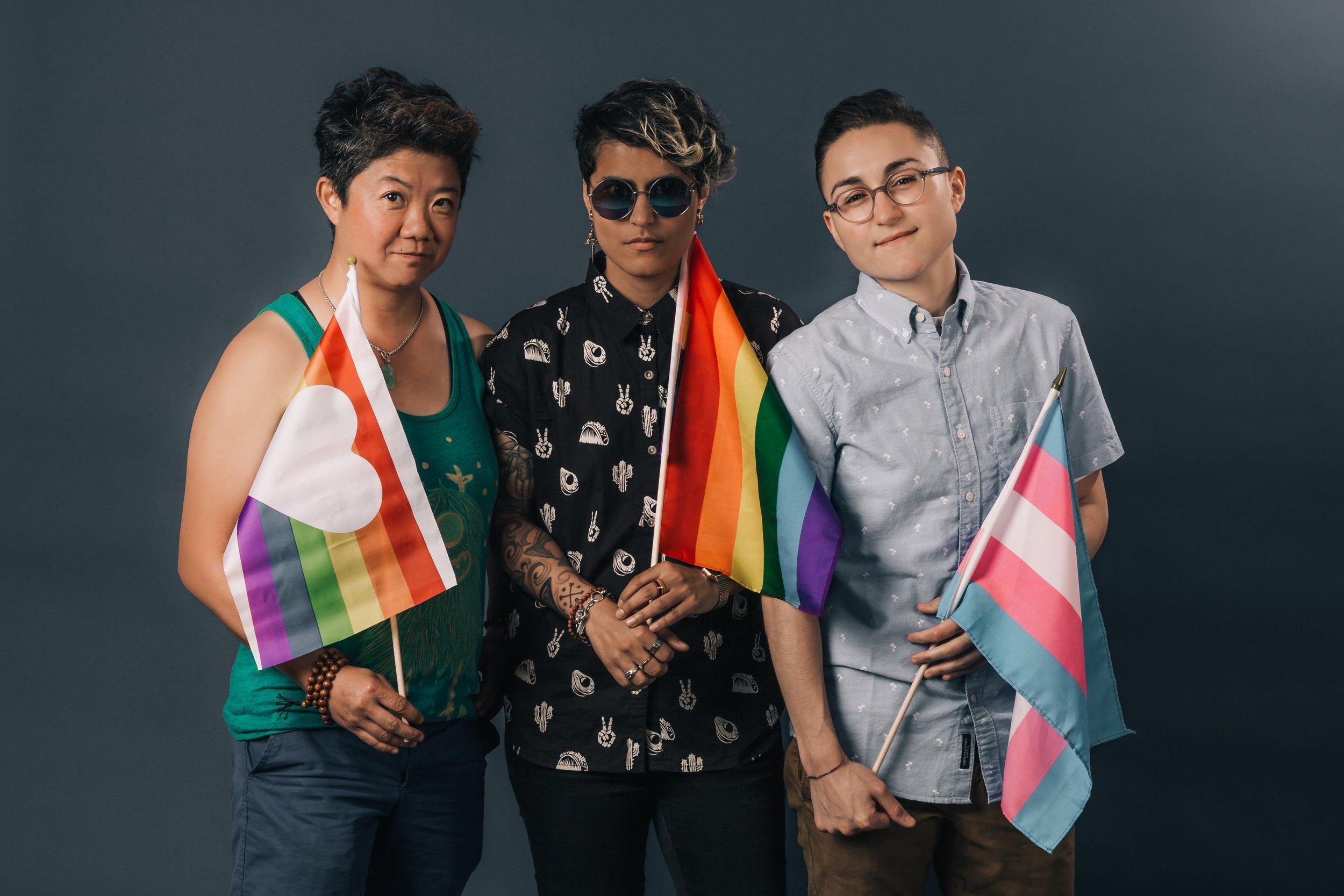 three-people-holding-pride-flags.jpg