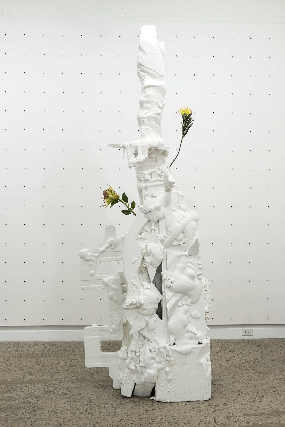 Philippe Caron Lefebvre,  Flèche,  2016, Polyurethane foam, polystyrene, paint and artificial flowers , variable dimensions