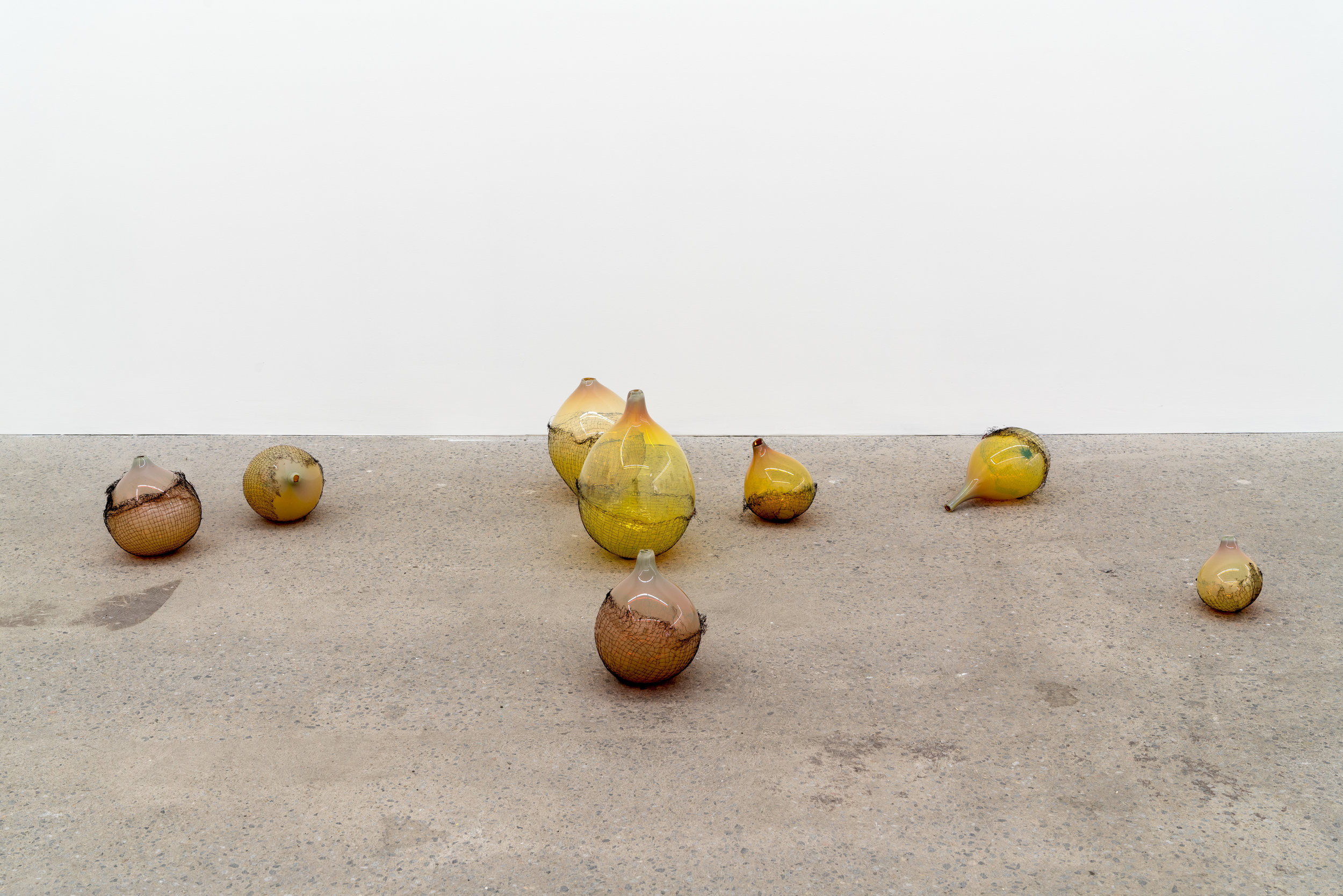 Lorna Bauer,  The Idlers , 2018, blown glass and copper mesh, variable dimensions