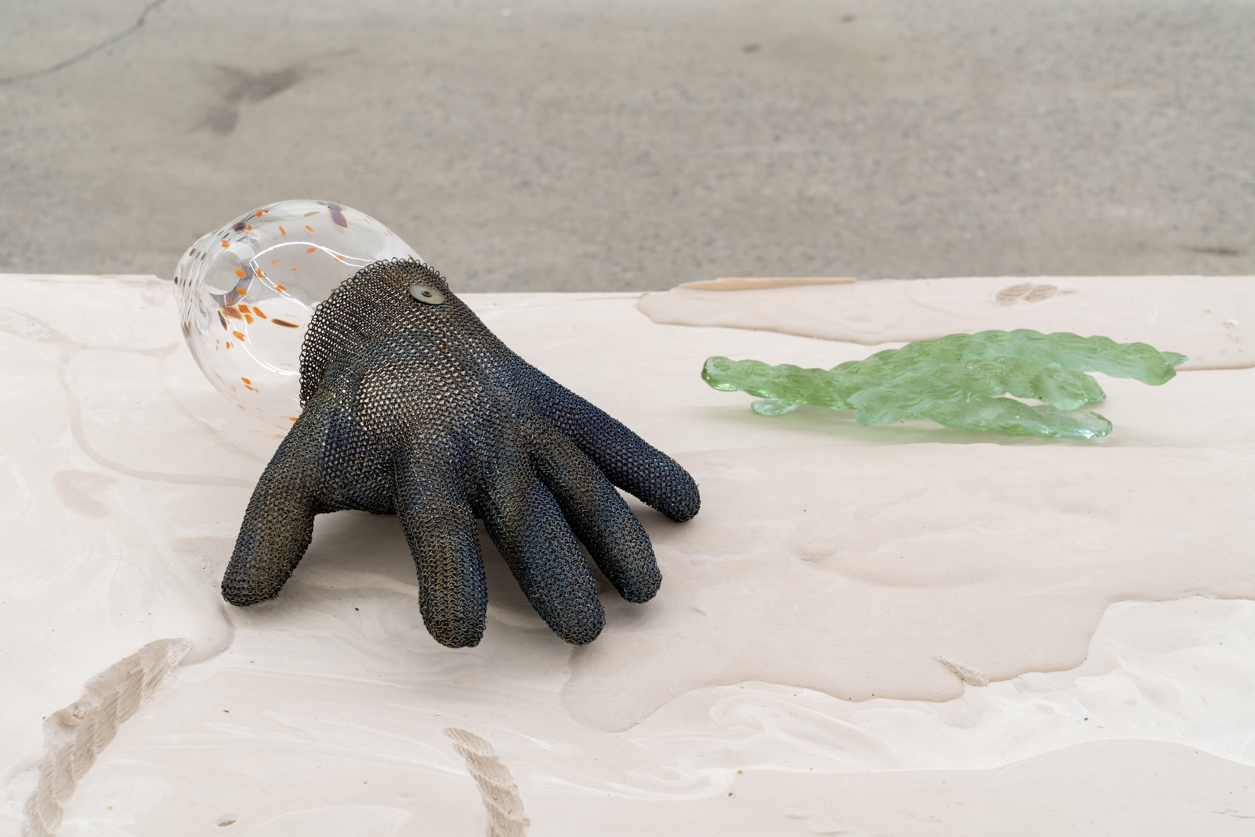 """Lorna Bauer,  The Hand of Mee and the Moonflower no.2 (detail),  2018, glown glass, butcher's glove, molded diachronic crystal, crystal sphere, plaster, wood, 20"""" x 36"""" x 84"""" (51 x 91 x 213 cm)"""