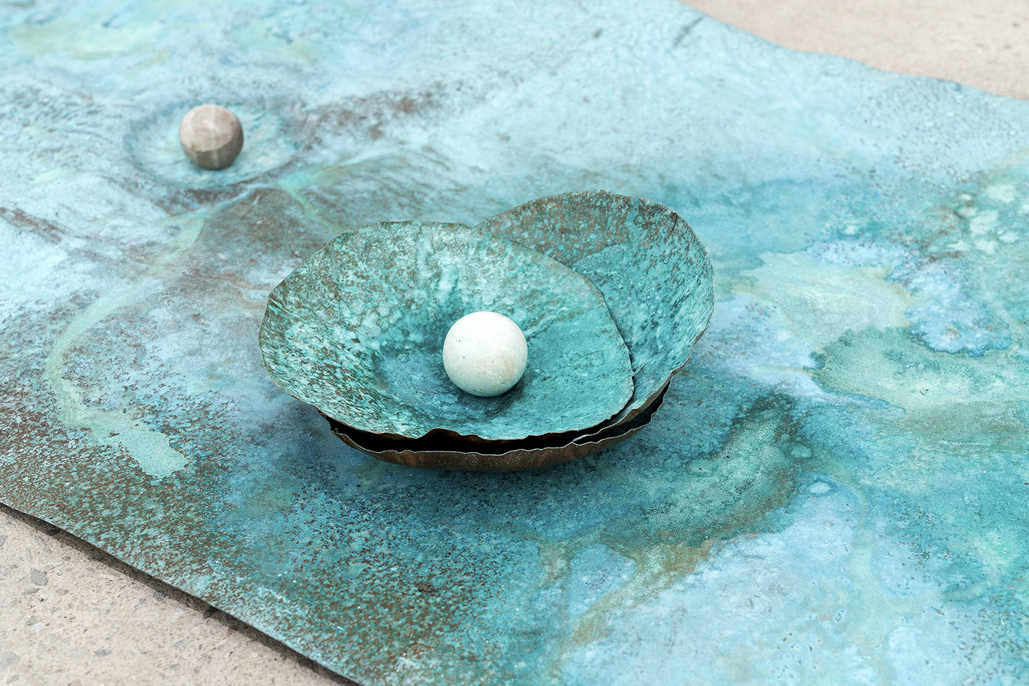 "Lorna Bauer,  The Toilers (detail) , 2018, copper, Miracle Grow patina, crystal sphere, 24"" x 48"" (61 x 122 cm)"