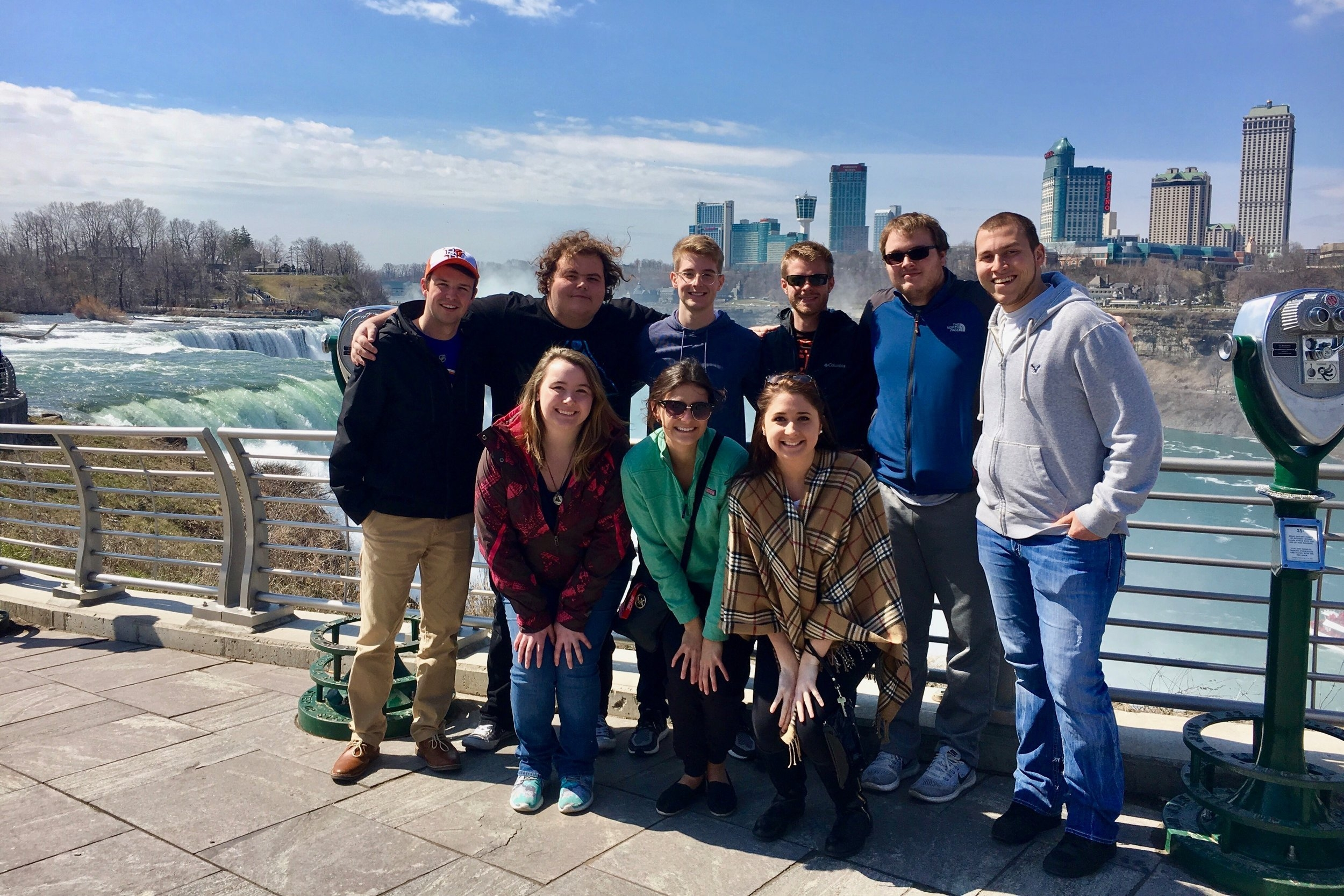 Buffalo, NY - The 2017 Spring Networking Trip took 10 members to Buffalo, Rochester, and Niagara Falls over the course of 3 days. They attended a Rochester Americans game, a Buffalo Bandits lacrosse game, and watched the Buffalo Sabres play against the New York Islanders. They also toured the Key Bank Center and Rochester's facility. After their tours, members met with professionals from the marketing team for the Buffalo Sabres and Bandits as well as a business operations executive from the Americans.