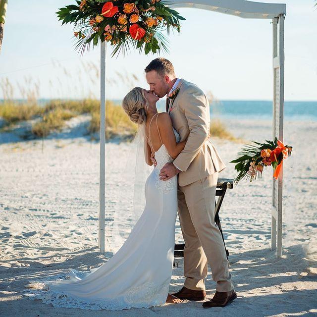Quintessential Florida vibes at Alicia @aokae7 and Mark's @insta_mark3 wedding 🏝 Stunning views, amazing couple and beautiful details... Florals: @wonderlandfloralart  Cake: @cakesbycarolynn  DJ: @eliteentertainmentdjs  HMUA: Christine At @femmeakoi  Venue: @grandplazaweddings  Dress: @beareroftheblingbridal  Bridesmaid Dresses: @iheartazazie  Bridal Shoes: Lulus Rings: @goldanddiamond_  Grooms Suit: @theblacktux . . . . . . #agameoftones #bridal #bride #creativewedding #floridawedding #floridaweddingphotographer #groom #heartandhazel #lookslikefilm #loveauthentic #outdoorwedding #portraits #realweddings #tampaelopement #tampaengagement #tampaengagementphotographer #tampawedding #tampaweddingphotographer #theknot #weddingday #weddingdress #weddingphotographer #weddingphotography #weddingpictures #weddingportrait #weddingwednesday #wedphotoinspiration #dvlop #stpetebeachwedding