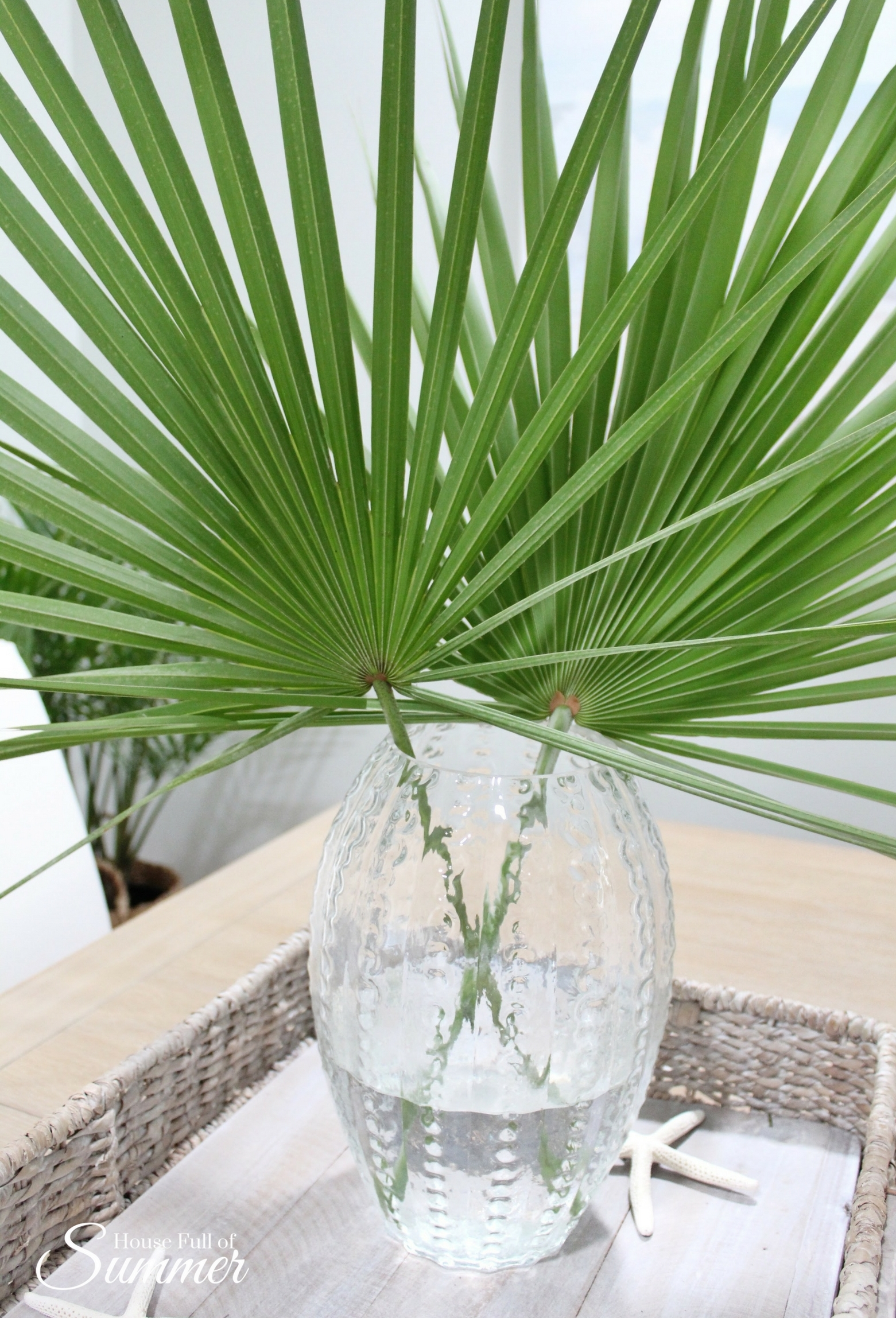 A vase full of fronds is always a good idea.