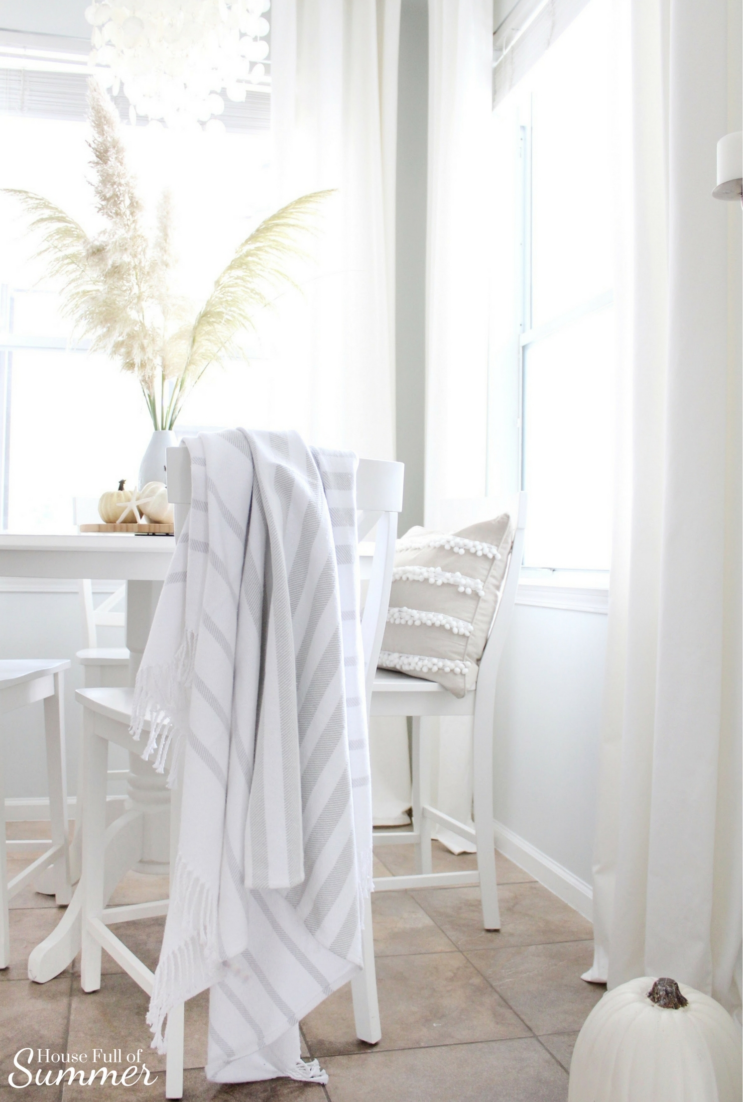 House Full of Summer: Fall Home Tour Blog Hop - Cozy, Coastal, Chic Breakfast nook fall decorating ideas. eat in kitchen, dining table, Neutral interior, white pumpkins, fall centerpiece, round counterheight table