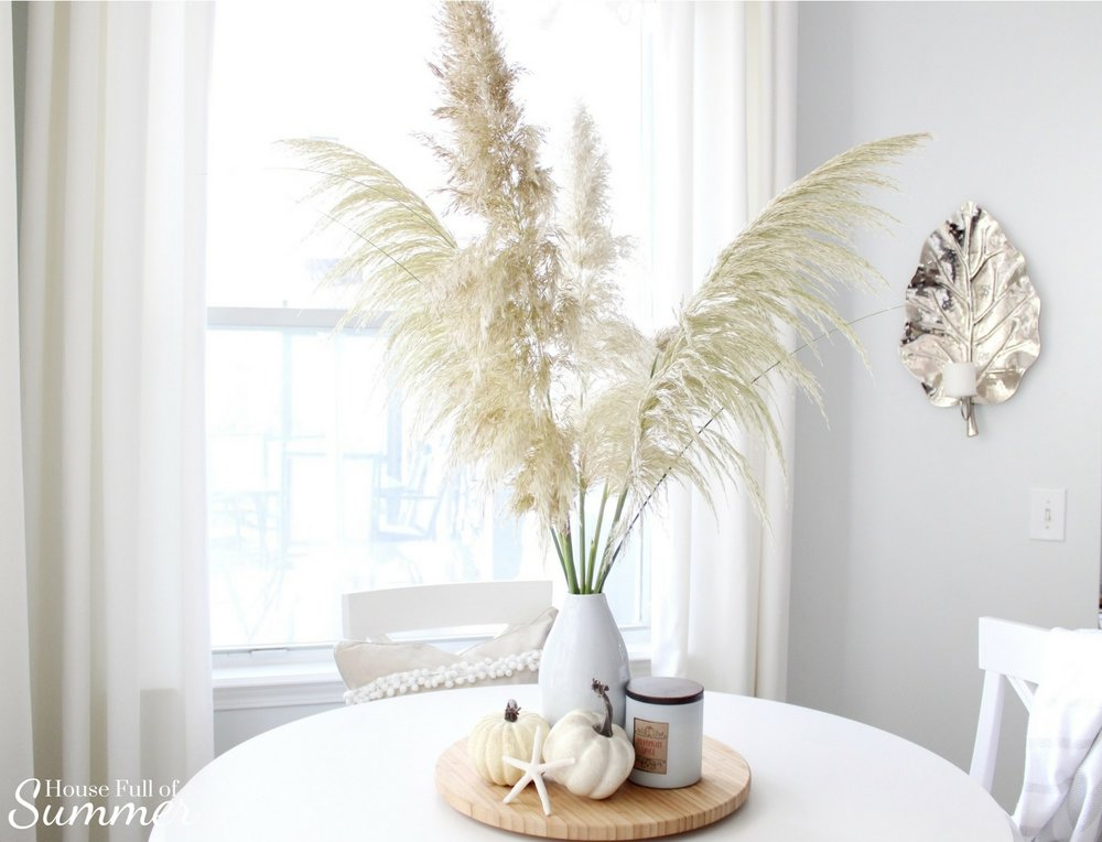 House Full of Summer: Fall Home Tour Blog Hop - Cozy, Coastal, Chic Breakfast Nook fall decorating ideas. eat in kitchen, dining table, Neutral interior, white pumpkins, fall centerpiece, round counter height table, natural decor