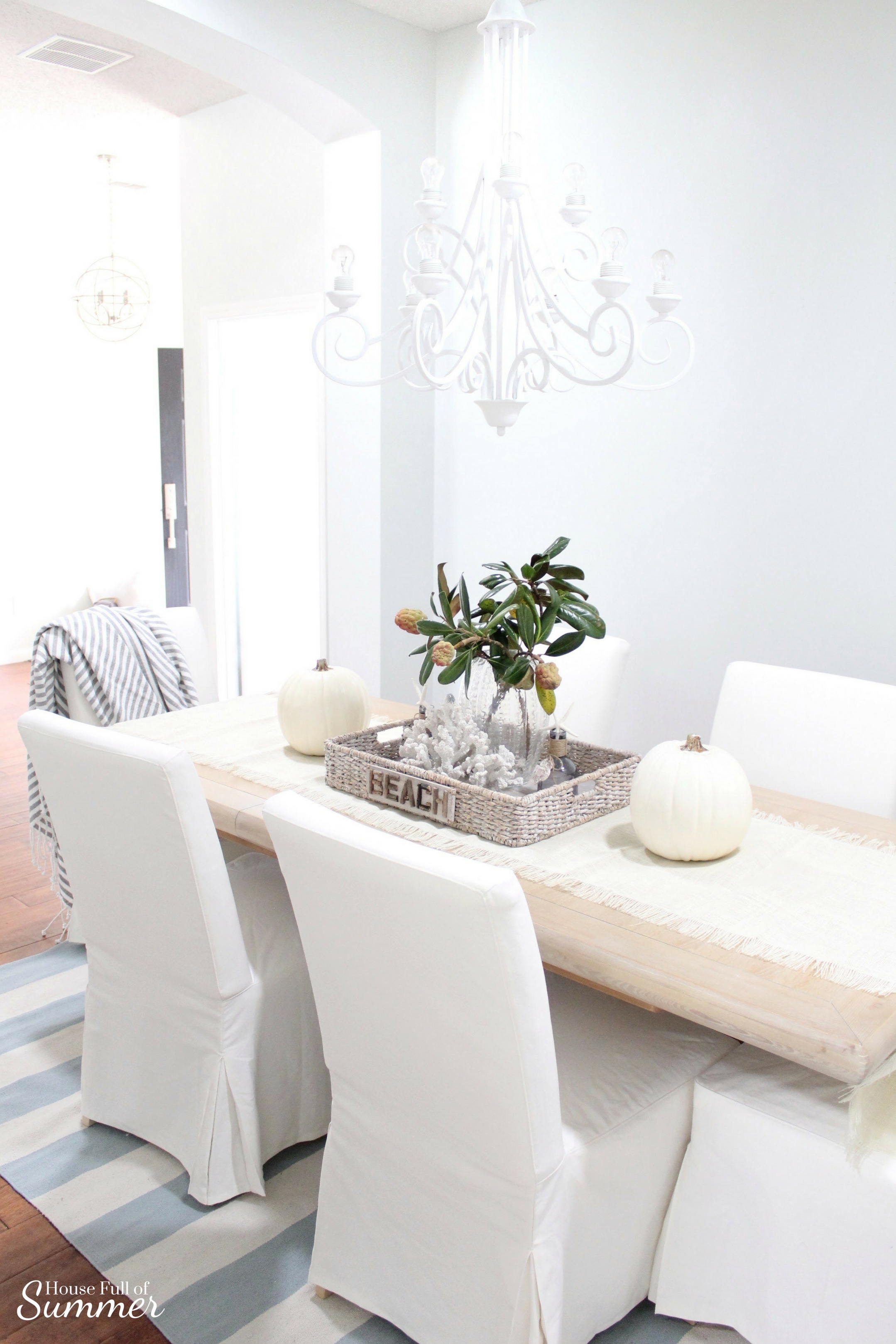 House Full of Summer: Fall Home Tour Blog Hop - Cozy, Coastal, Chic Dining Room, pottery barn style, beachy decor, coral, starfish, magnolia leaves, tray styling ideas, table decor, diy ideas, white chandelier, painted chandelier, chalk paint, striped rug, jute