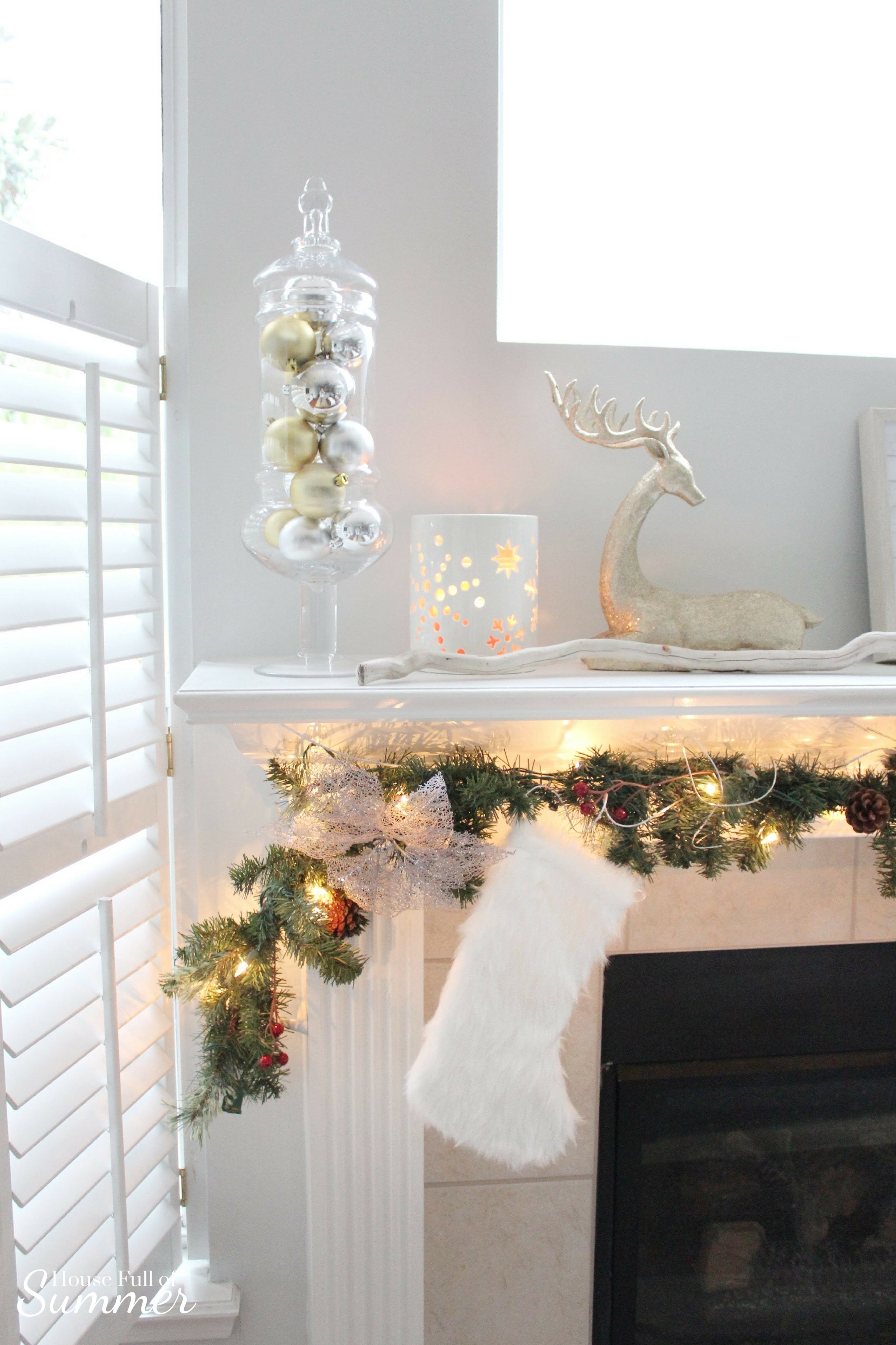 Creating a Glam Coastal Christmas with Bealls Florida | House Full of Summer blog - neutral christmas decor, gold coastal christmas throw pillow, tassel pillow, decorative pillow, florida christmas, beachy holiday decor, mantel decor, fur stockings, fireplace garland, silver and gold ornaments,