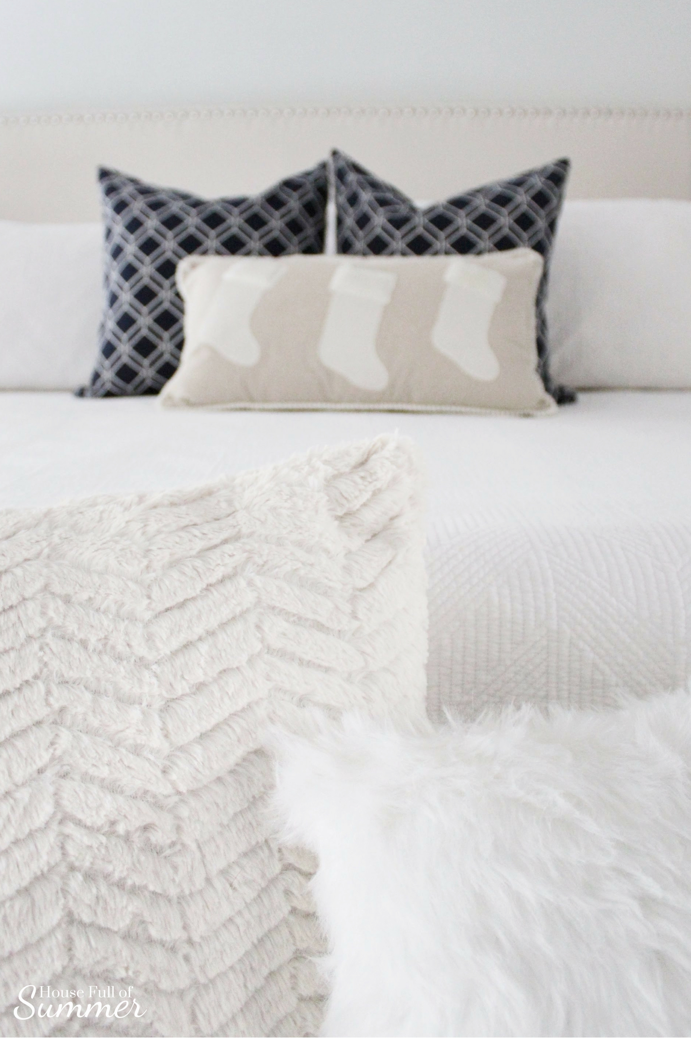 Classy Christmas Home Tour {Part Two} | House Full of Summer blog - Christmas bedding, neutral bedroom decor, navy and white Christmas ideas, Navy and white Christmas bedroom, blue christmas decorations, coastal home, blue and white area rug, tall nightstands