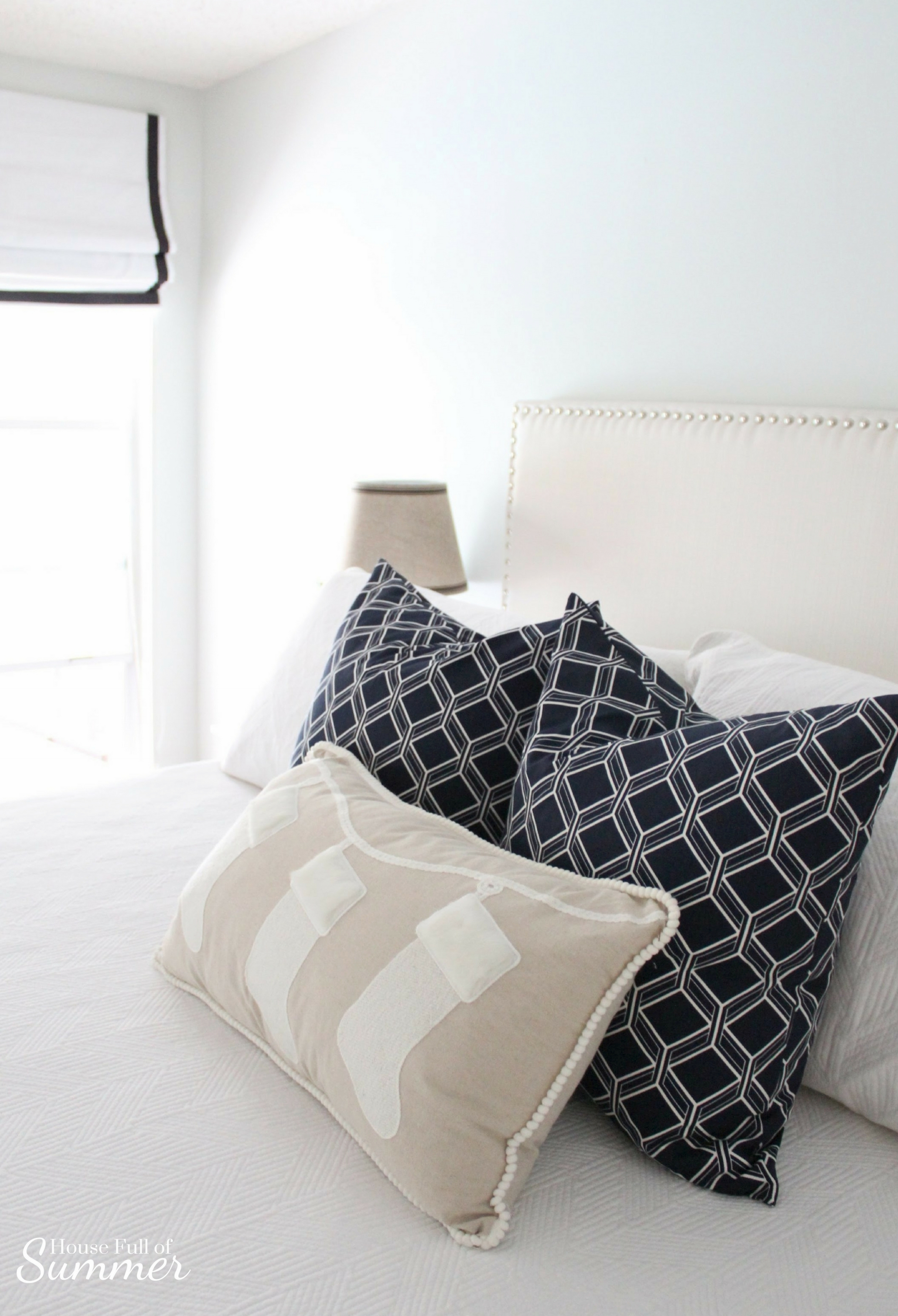 Classy Christmas Home Tour {Part Two} | House Full of Summer blog - Christmas bedding, neutral bedroom decor, navy and white Christmas ideas, Navy and white Christmas bedroom, blue christmas decorations, coastal home, blue and white area rug, tall nightstands, throw pillows, pottery barn style, roman shades