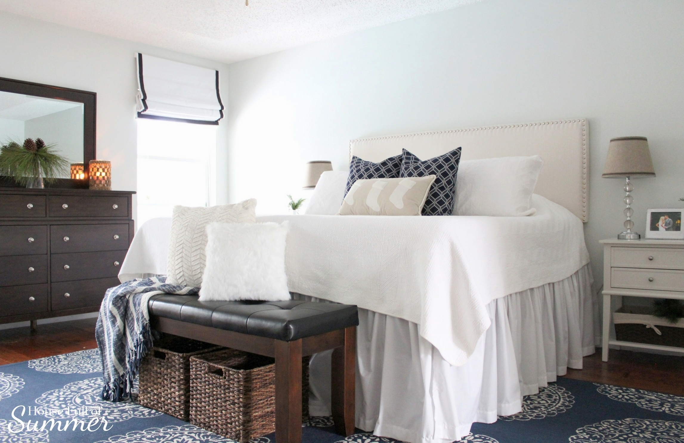 Classy Christmas Home Tour {Part Two} | House Full of Summer blog - Christmas bedding, neutral bedroom decor, navy and white Christmas ideas, Navy and white Christmas bedroom, blue christmas decorations, coastal home, blue and white area rug, tall nightstands, Christmas greenery, roman shades, pottery barn style