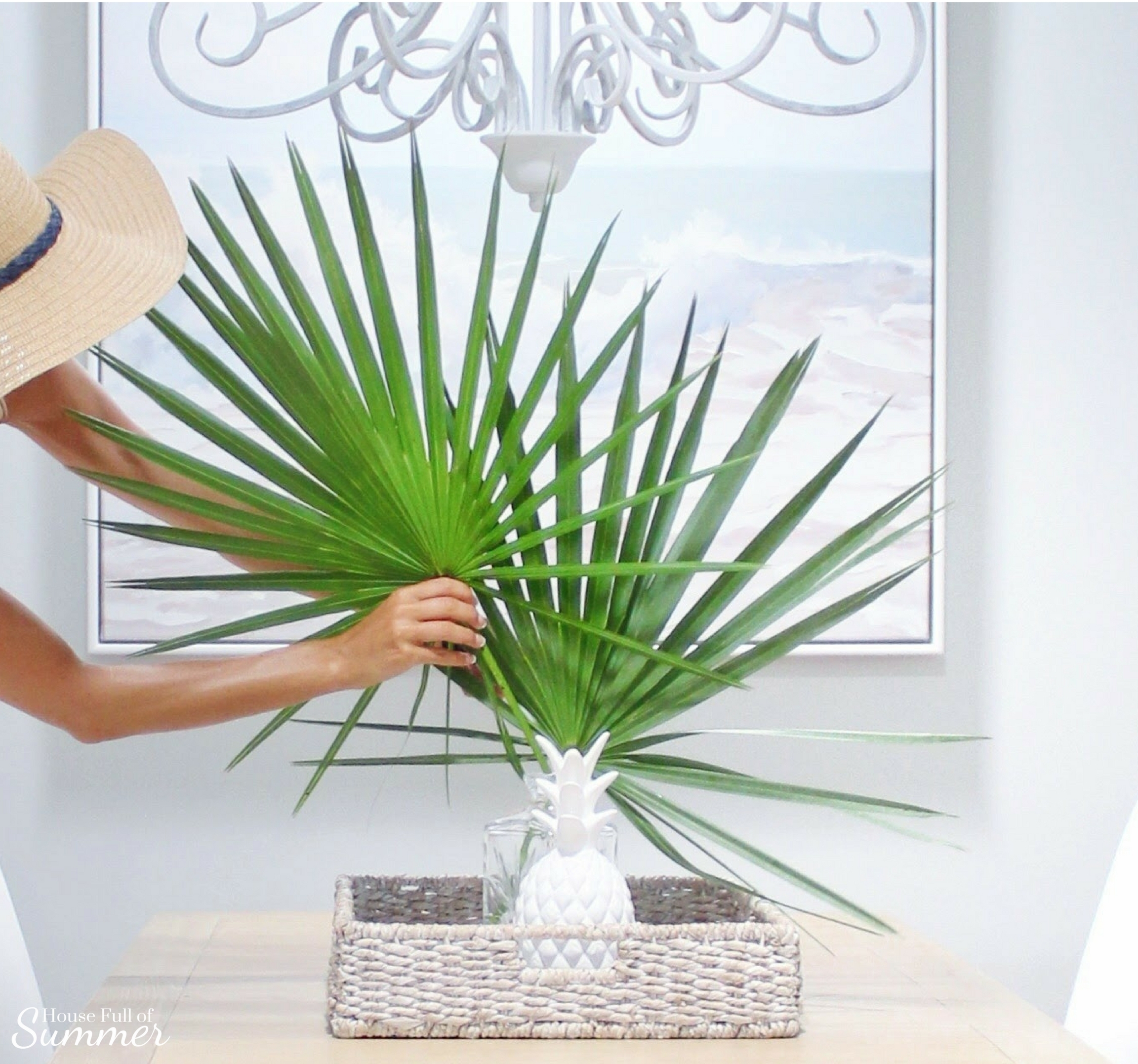 Add New Life to Your Home With This New Year's Resolution | House Full of Summer blog adding greenery to your home, decorating with plants, fronds, trimmings, winter decor, home decor, coastal dining room decor, beach art, ocean waves, saw palmetto fronds, white pineapple, dining centerpiece, tropical style