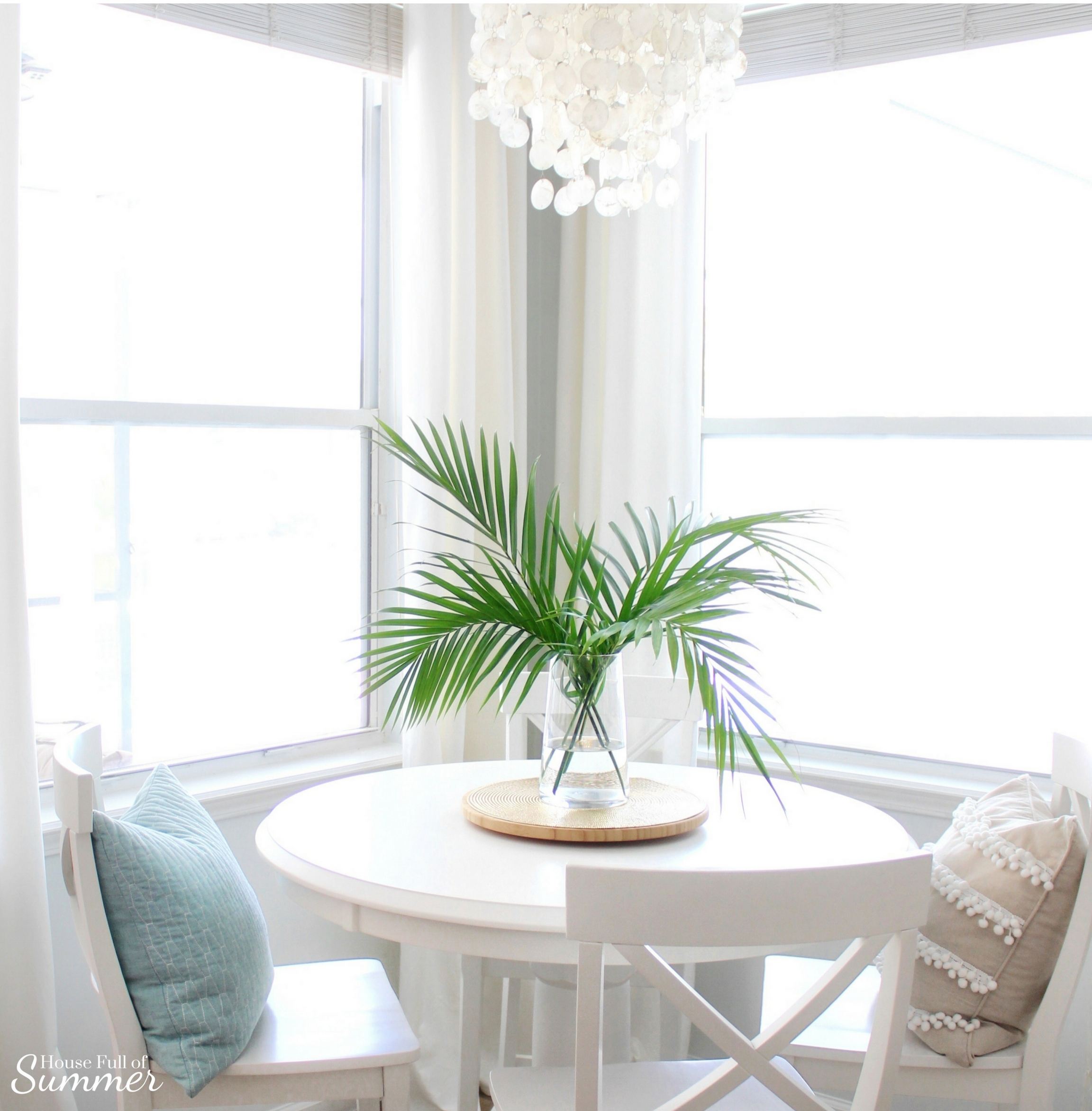 Add New Life to Your Home With This New Year's Resolution | House Full of Summer blog adding greenery to your home, decorating with plants, fronds, trimmings, winter decor, home decor, coastal home interior, capiz chandelier, decor on a budget, spring decor ideas,  hamptons style, white breakfast nook, extra long white curtains, summer decor, fronds