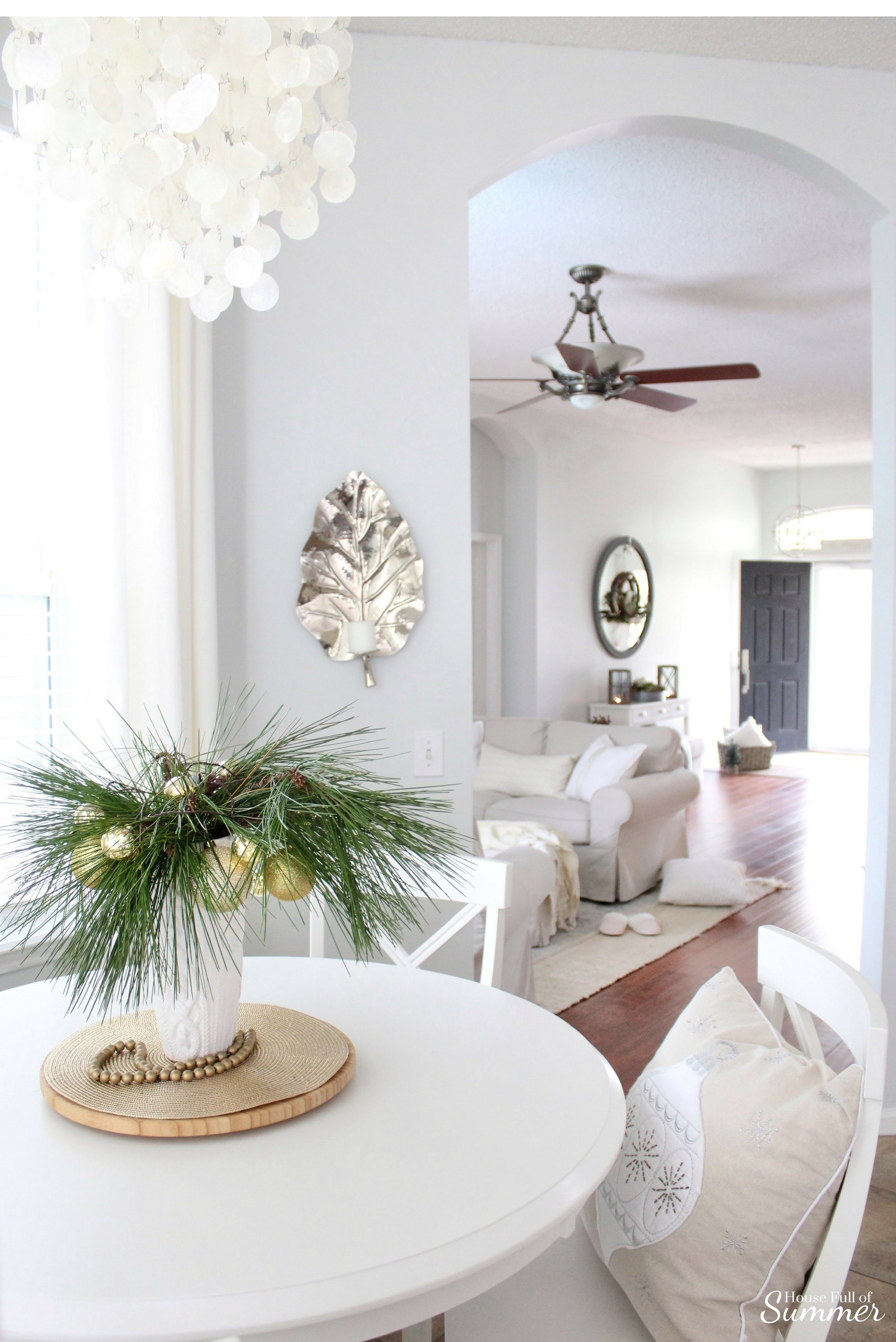 Add New Life to Your Home With This New Year's Resolution | House Full of Summer blog adding greenery to your home, decorating with plants, fronds, trimmings, winter decor, home decor, coastal home interior, capiz chandelier, decor on a budget,  hamptons style, white breakfast nook, extra long white curtains, coastal winter ideas