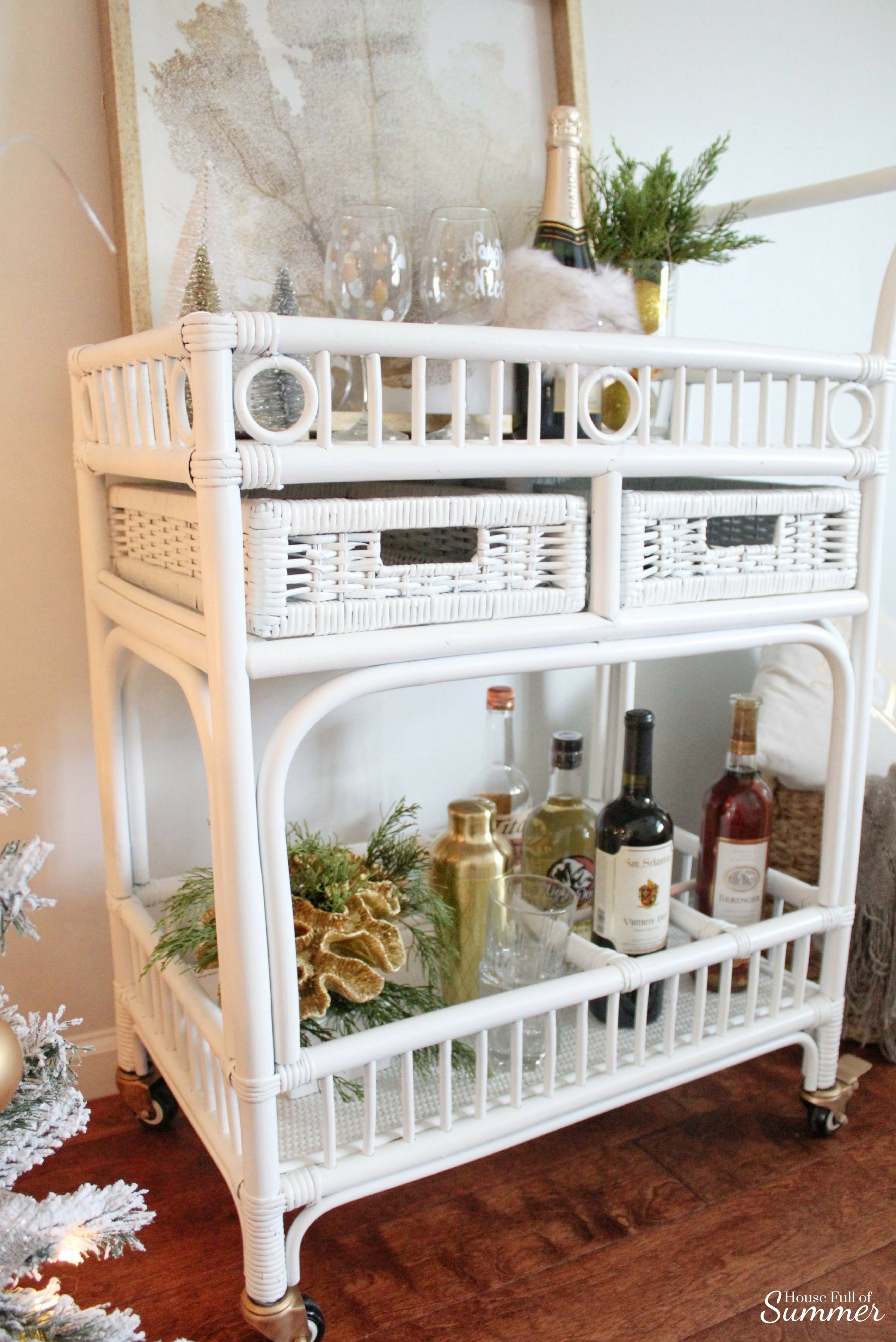 Add New Life to Your Home With This New Year's Resolution | House Full of Summer blog adding greenery to your home, decorating with plants, fronds, trimmings, winter decor, home decor, coastal home interior, white bar cart, rattan cart, coastal winter greenery ideas