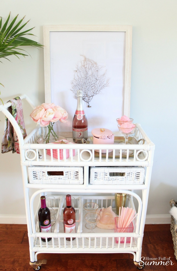 Blush Valentine's Day Cart With a Coastal Touch | House Full of Summer blog white cane bar cart, coastal bar cart styling, pink and gold valentine's day decor, tropical style, coastal home decor, framed sea fan, blush flowers, tray styling, cotton candy rose champagne cocktail drink vintage gold rimmed glasses, diy bar cart painted