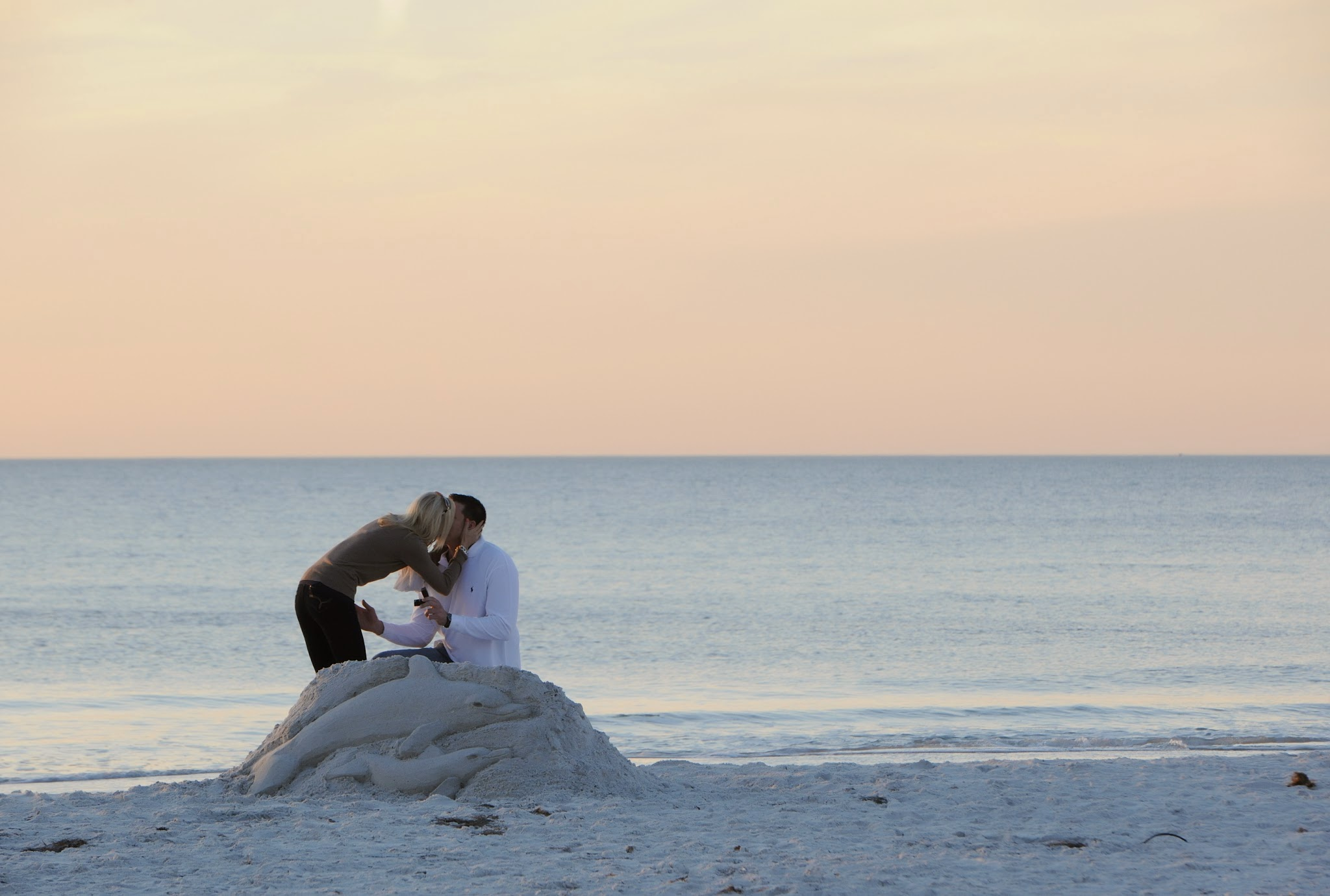 The Pink Palace Proposal | House Full of Summer - A romantic beach proposal at the Don CeSar on St. Pete Beach, Florida,  sand sculpture proposal, beach engagement, sunset proposal on the beach, secret photographer, how he asked, best wedding proposal, creative proposal , must love dogs, dog wedding proposal