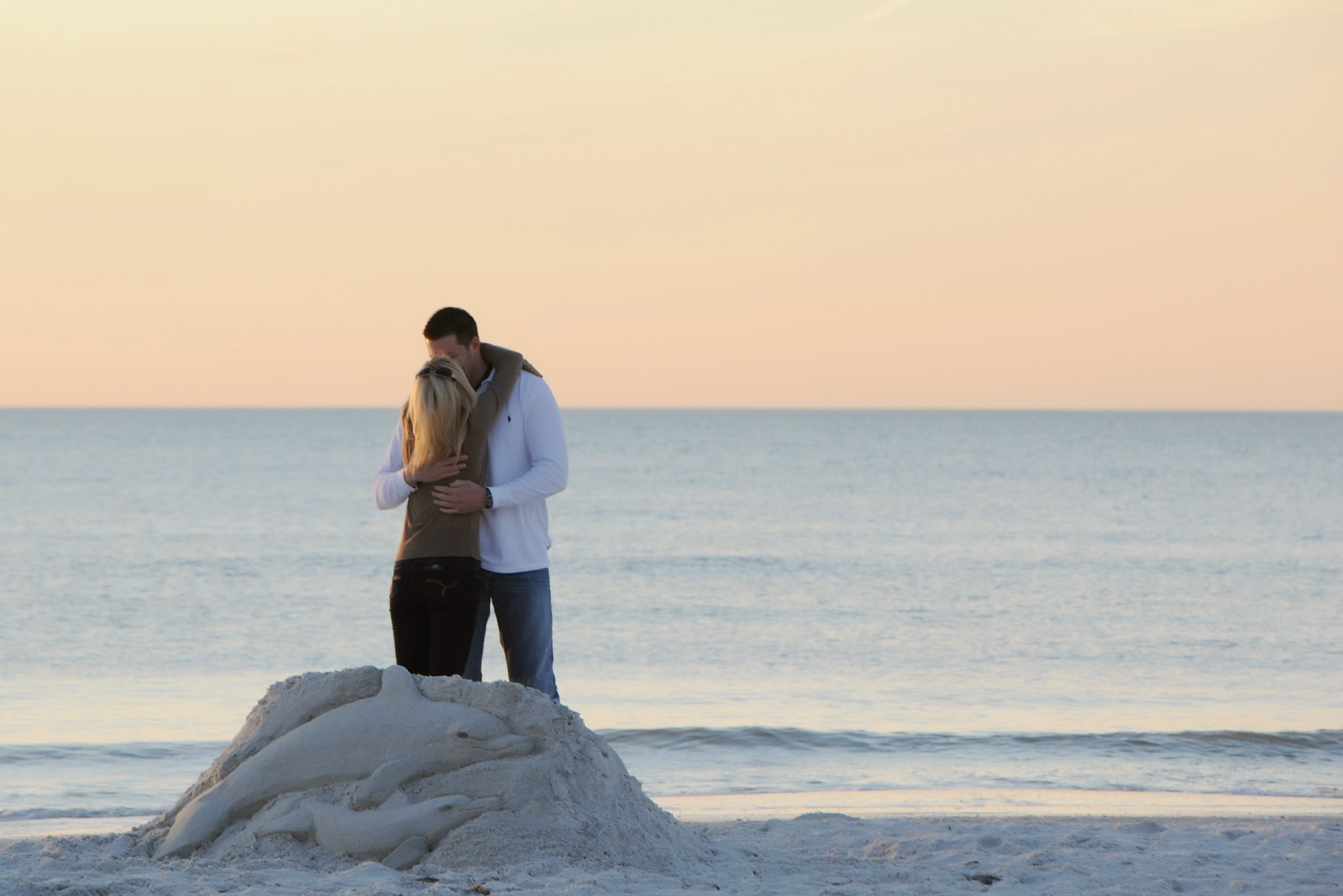 The Pink Palace Proposal | House Full of Summer - A romantic beach proposal at the Don CeSar on St. Pete Beach, Florida,  sand sculpture proposal, beach engagement, sunset proposal on the beach, secret photographer, how he asked, best wedding proposal, creative proposal , must love dogs, dog wedding proposal , dolphin sculpture
