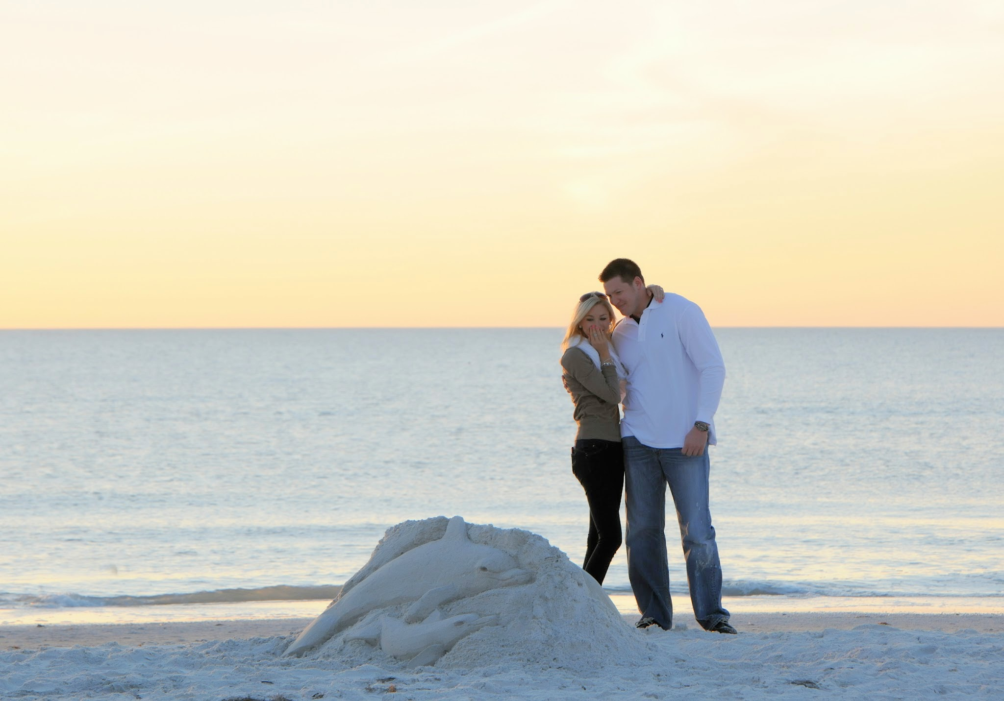 The Pink Palace Proposal | House Full of Summer - A romantic beach proposal at the Don CeSar on St. Pete Beach, Florida,  sand sculpture proposal, beach engagement, sunset proposal on the beach, secret photographer, how he asked, best wedding proposal, creative proposal , must love dogs, dog wedding proposal, dolphin sand sculpture