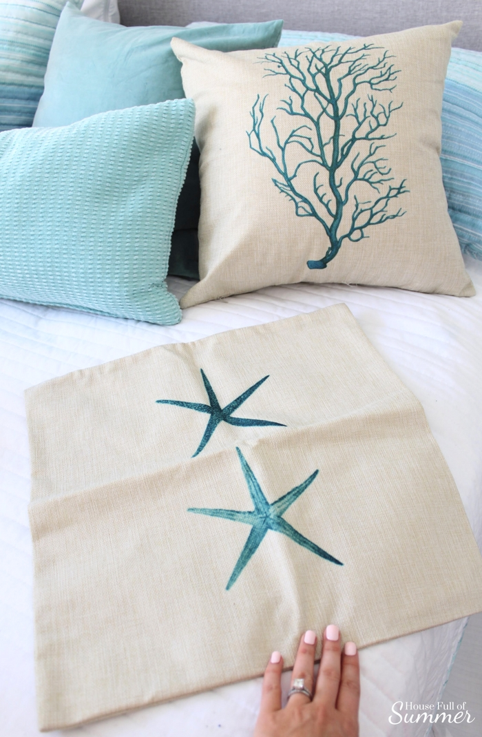 How to Store Seasonal Pillows by Hiding Them in Plain Sight | House Full of Summer - what to do with extra pilows, throw pillow storage solutions, christmas pillow storage, coastal pillow covers, starfish coral seahorse seafan cushion covers, cheap throw pillow ideas, how to repurpose pillows, coastal bedroom, guest room, white bedding, gray headboard, happiness is a day at the beach, coastal beachy wall decor
