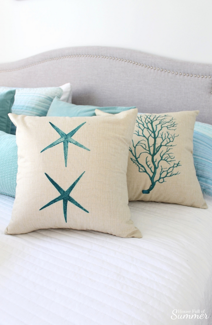 How to Store Seasonal Pillows by Hiding Them in Plain Sight | House Full of Summer - what to do with extra pilows, throw pillow storage solutions, christmas pillow storage, coastal pillow covers, starfish coral seahorse seafan cushion covers, cheap throw pillow ideas, how to repurpose pillows, coastal bedroom, guest room, white bedding, gray headboard, happiness is a day at the beach, coastal beachy wall decor teal pillow covers, linen burlap