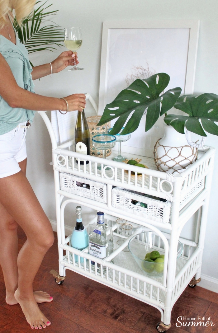 Loveliest Looks of Summer Tour | Fresh & Breezy Summer Style - coastal home decor for summertime, summer outfit ideas, ruffle top, tassel earrings, living room decor, dining room decor, tropical greenery, decor on a budget, free ways to decorate, foyer styling, cane bar cart styling