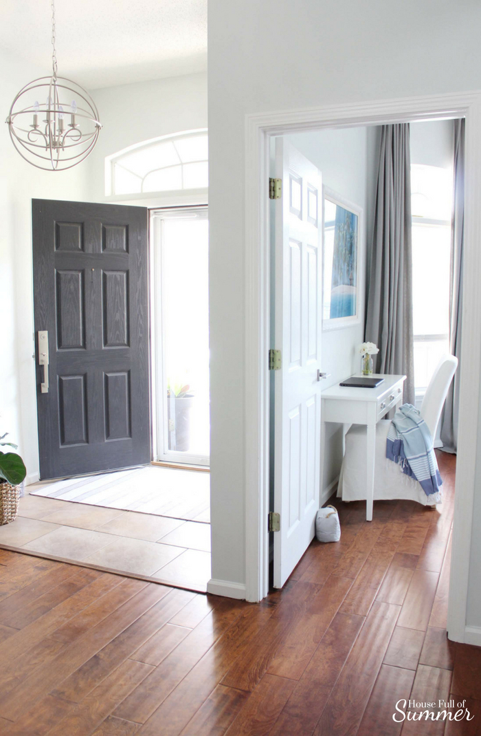Adding an Office Space to a Guest Room | House Full of Summer - coastal bedroom decor, beachy guest room, desk in a bedroom, multipurpose spaces, home office ideas, desk, console table, white slipcovered chair, beach art, extra tall curtains, long curtains, Florida home, beach house style, blue gray white interior