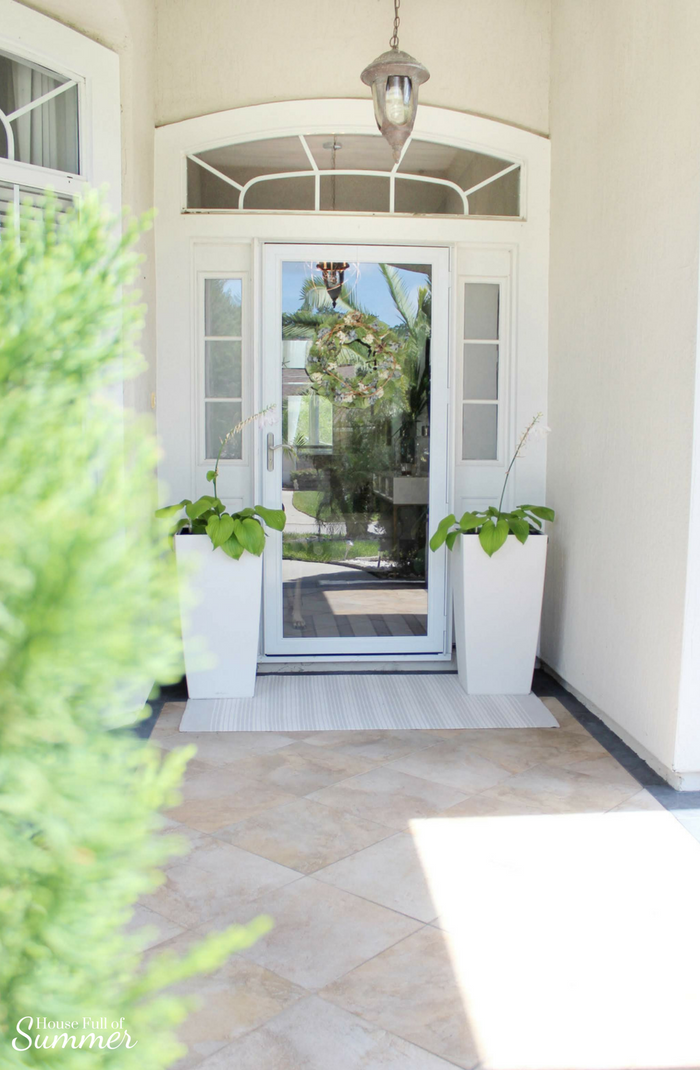Self-Watering Planters and a Stylish Front Porch | House Full of Summer - front porch decor, white tall planters, summer front porch, summer decor, coastal home exterior, white porch, Florida home, Jackson & Perkins #housefullofsummer #sp