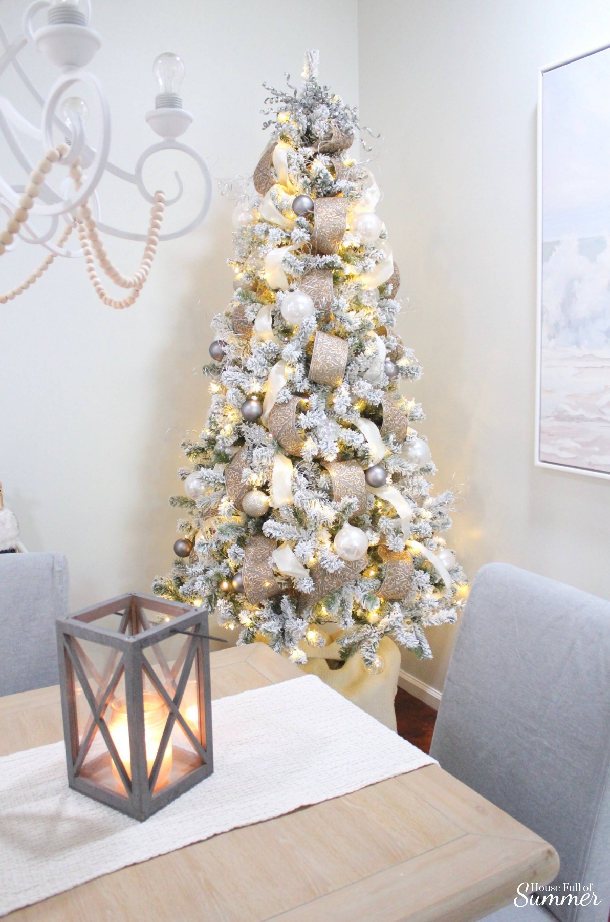 A Charming Southern Christmas Home Tour {Part 1} | House Full of Summer - Gold Magnolias and Southern influences in Christmas decor, neutral Christmas decorating, foyer, living room, Christmas centerpiece, greenery, DIY holiday arrangement, coastal decor, Southern Christmas tree ornament ideas