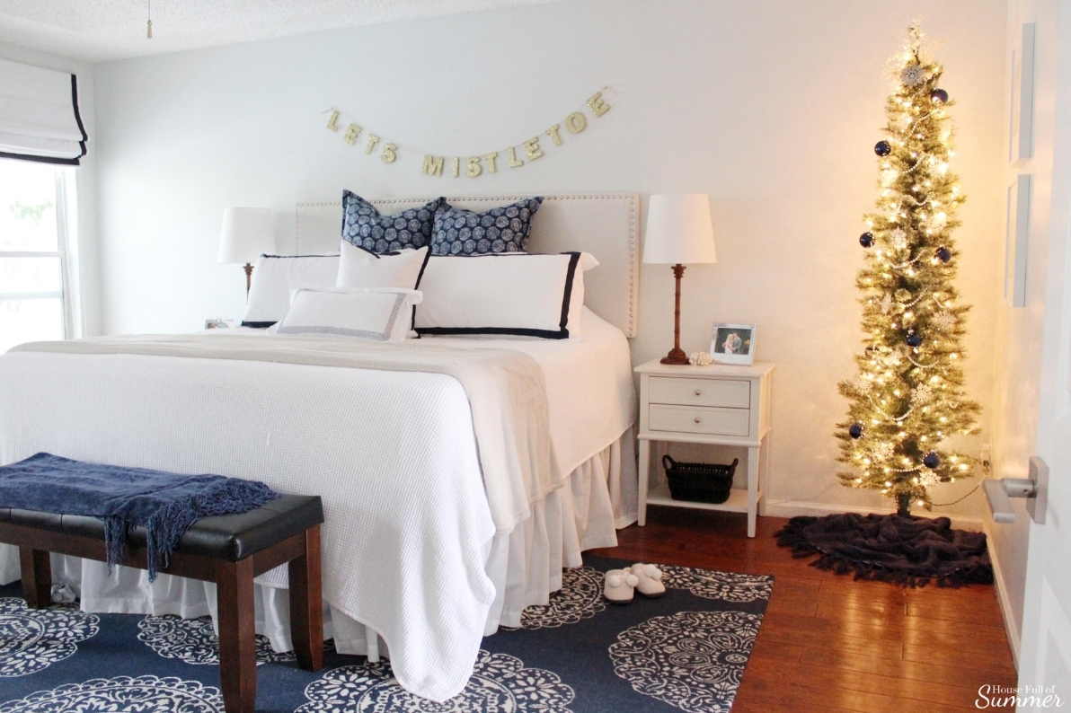 A Charming Southern Christmas Home Tour {Part 2} | House Full of Summer - Master Bedroom Christmas decor ideas, navy Christmas decorations, blue and white holiday decor, foyer, Gold Magnolias and Southern influences in Christmas decor, neutral Christmas decorating, foyer, living room, Christmas centerpiece, greenery, DIY holiday arrangement, coastal decor, Southern Christmas tree ornament ideas tassel ornaments
