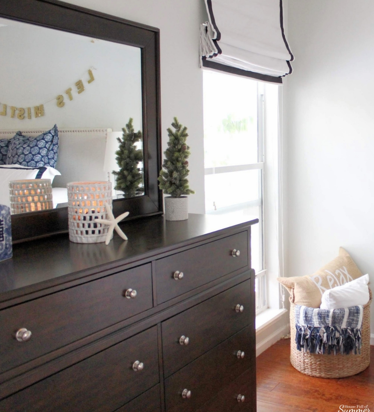 A Charming Southern Christmas Home Tour {Part 2} | House Full of Summer - Master Bedroom Christmas decor ideas, navy Christmas decorations, blue and white holiday decor, foyer, Gold Magnolias and Southern influences in Christmas decor, neutral Christmas decorating, foyer, living room, Christmas centerpiece, greenery, DIY holiday arrangement, coastal decor, Southern Christmas tree ornament ideas tassel ornaments, roman shades