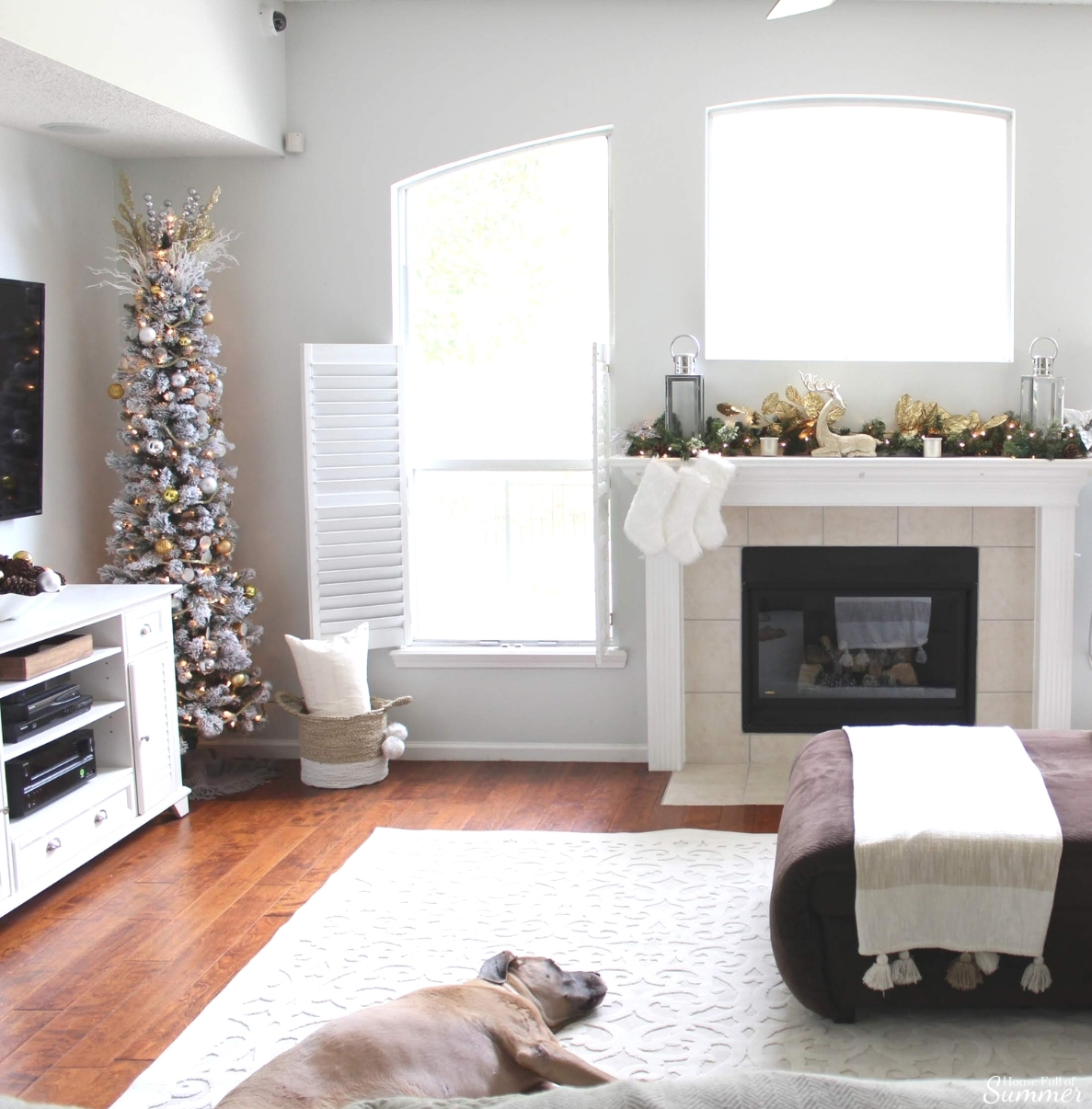 A Charming Southern Christmas Home Tour {Part 2}   House Full of Summer - Master Bedroom Christmas decor ideas, navy Christmas decorations, blue and white holiday decor, foyer, Gold Magnolias and Southern influences in Christmas decor, neutral Christmas decorating, foyer, living room, Christmas centerpiece, greenery, DIY holiday arrangement, coastal decor, Southern Christmas tree ornament ideas tassel ornaments, white durable rug, rugs for dogs, indoor outdoor rug, boucle rug, family room, Christmas mantle