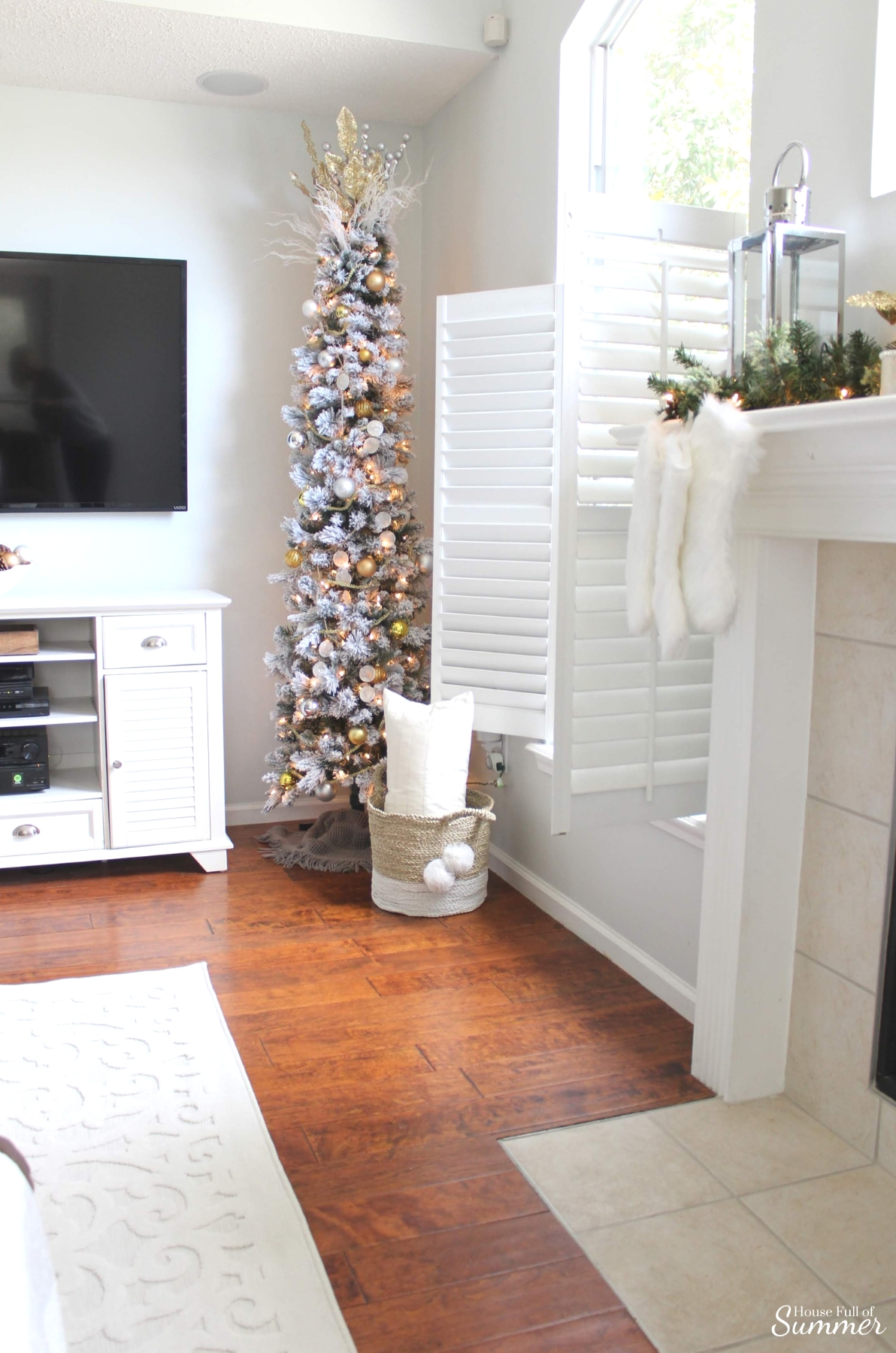 A Charming Southern Christmas Home Tour {Part 2} | House Full of Summer - Master Bedroom Christmas decor ideas, navy Christmas decorations, blue and white holiday decor, foyer, Gold Magnolias and Southern influences in Christmas decor, neutral Christmas decorating, foyer, living room, Christmas centerpiece, greenery, DIY holiday arrangement, coastal decor, Southern Christmas tree ornament ideas tassel ornaments, flocked pencil tree, mantle decor, coastal home christmas