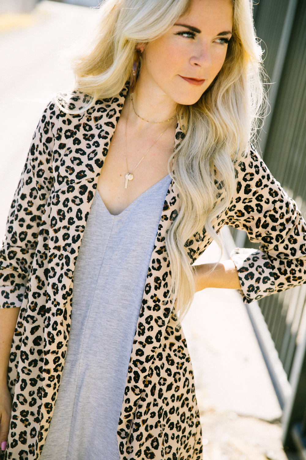 Top Las Vegas fashion blog, Life of a Sister, shares their tips on how to style your Shopbop Romper: image of a woman wearing a leopard print blazer, Sam Edelman pink pumps and a Shopbop grey romper