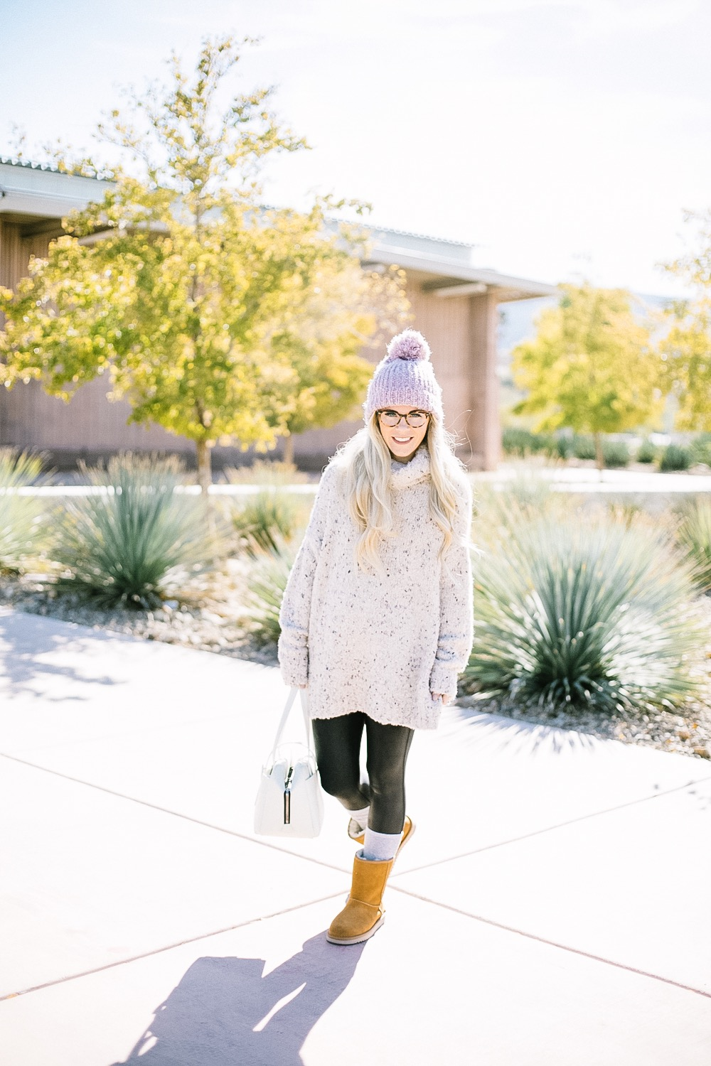 Holiday Shoe Gift Ideas with Kohls featured by top Las Vegas fashion blog, Life of a Sister: image of a woman wearing Koolaburras