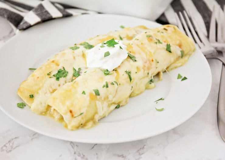 Easy Chicken Enchiladas Recipe featured by top US foodie blog, Life of a Sister