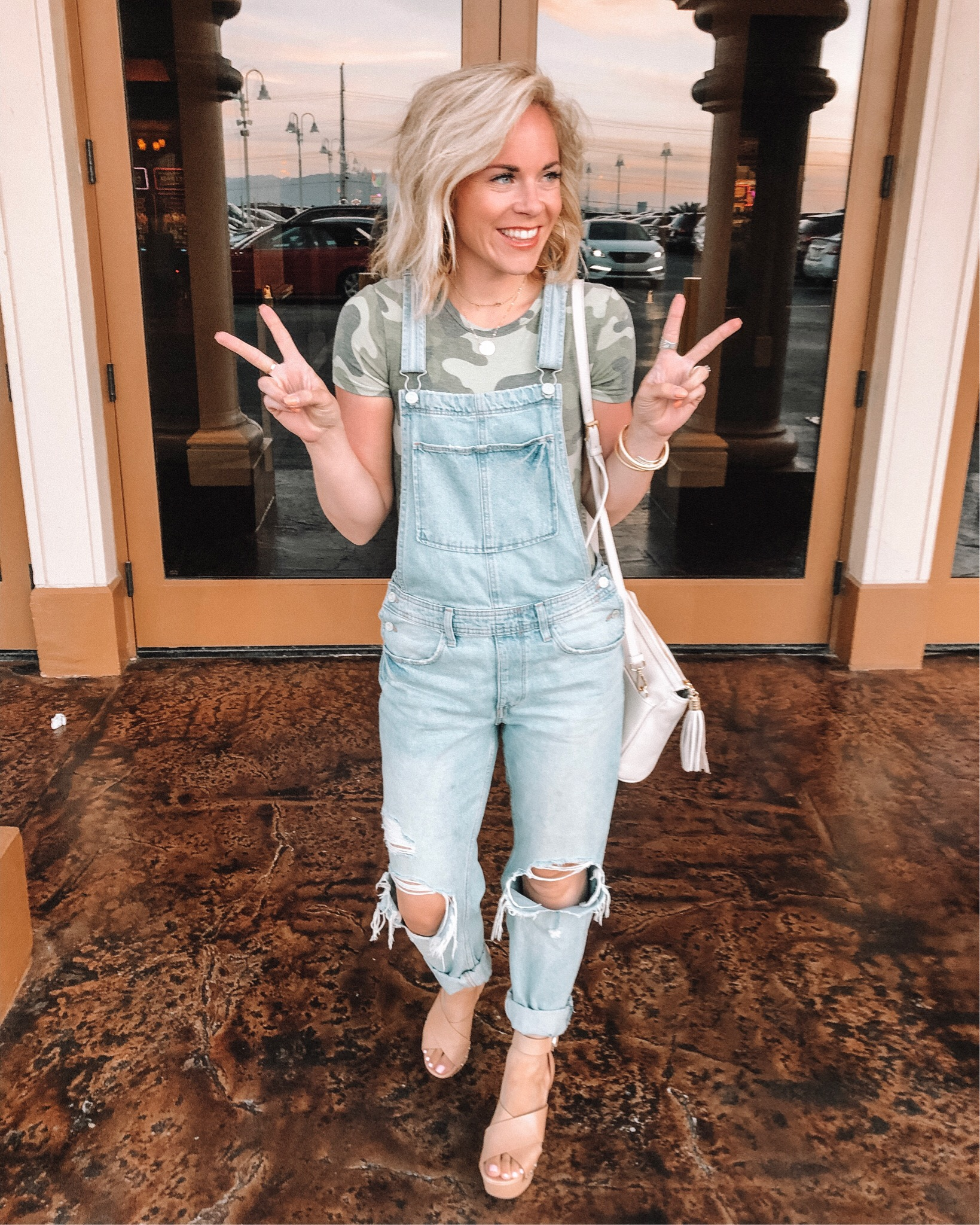 Denim trend featured by top US fashion blog, Life of a Sister: image of a woman wearing denim overalls