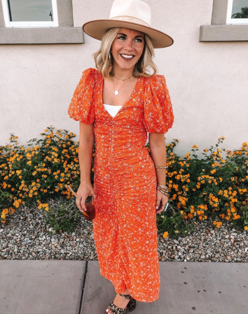 Trending Colors for Summer featured by top US fashion blog, Life of a Sister: image of a woman wearing an orange maxi dress