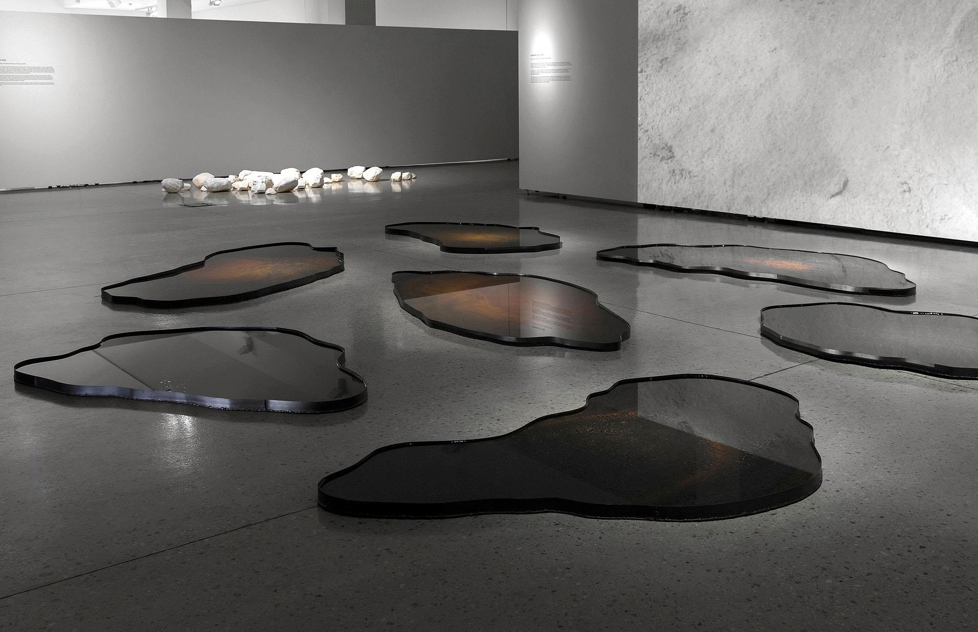 GARDENS OF STONE  Steel, natural patina, water, HD digital video projection (loop)